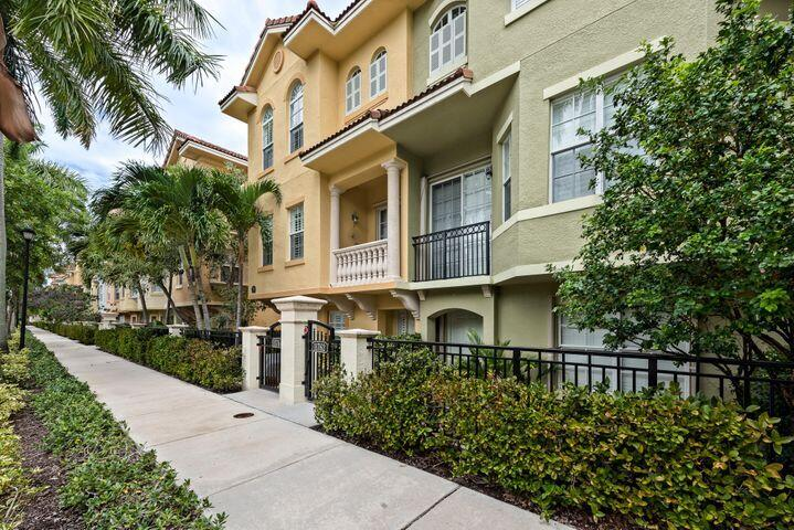 This beautiful 3 story townhome features 3 bedrooms 3.5 baths plus a 2 car garage. Enjoy the private paver courtyard or covered balcony for outdoor enjoyment. Located near Downtown Gardens and The Gardens Mall.