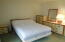 Bed frame and mattress, and long dresser w/mirror do not convey.