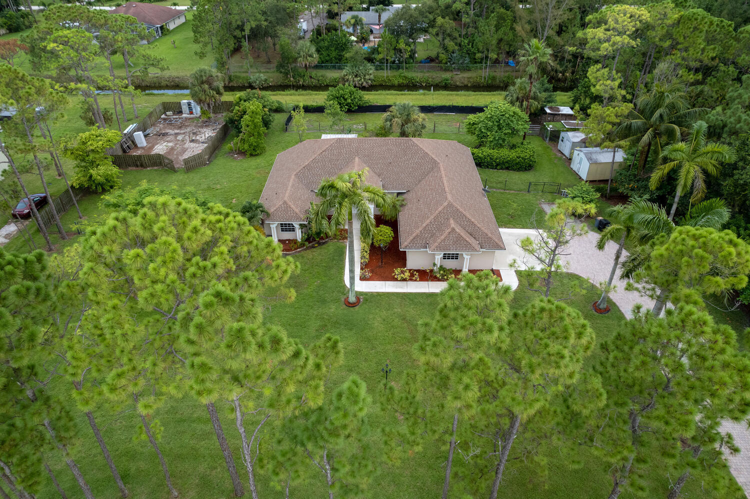 Beautiful 3 BR2.1BA2CG home on a 1.3 Acre fully fenced lot in a prime eastern Loxahatchee location next to Bay Hill Estates.Features include an open floor plan,10'ceilings,diagonal tile in living area,wood plank tile in all bedrooms,new impact sliders,LED hi hats,water softener/RO Carbon water system.Enjoy the privacy of this oversized covered screened in patio and tropical landscaping complete with mature Royal and Coconut Palms.Kitchen offers custom wood cabinetry with Island and stainless appliances including cooktop with charcoal hood/convection oven,granite countertops.Master ensuite offers dual vanities,dual walk in closets,soaking tub and oversized walk in shower.Freshly painted interior and exterior with all new baseboards and newly tiled patio.No HOA-boats,RVs and horses welcome!