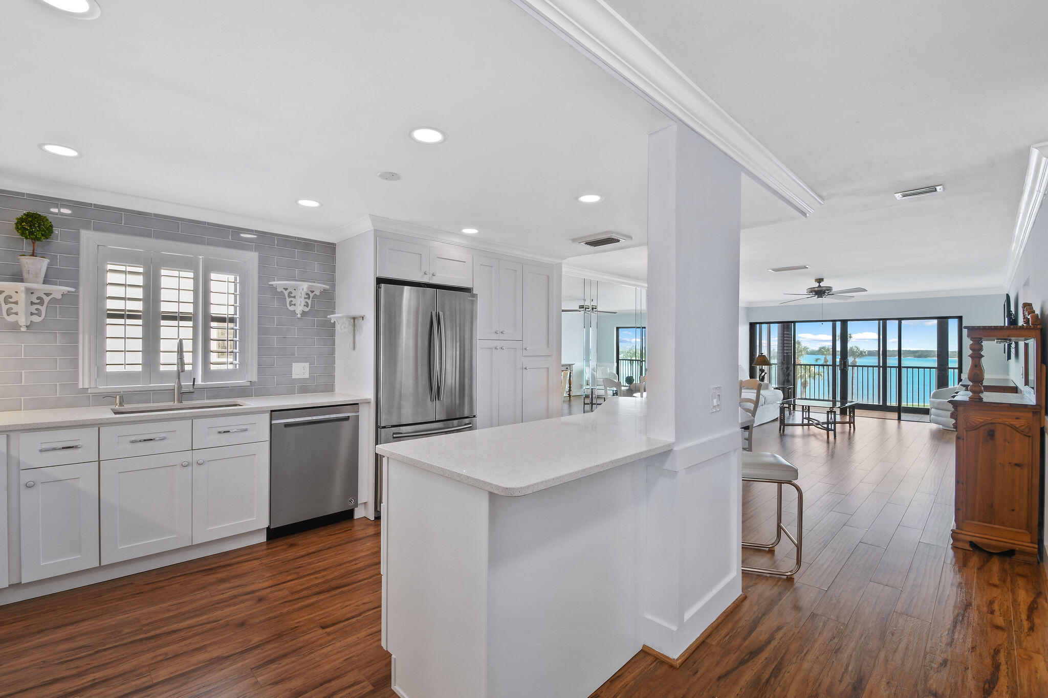 Beautifully decorated waterfront END CORNER UNIT with Endless views looking straight out North of the  most beautiful blue Intracoastal waters. This community is tucked away in the North Corner of Palm Beach County.  Walking distance to shopping and restaurants and a short bike ride to the most fabulous beaches.  Beautifully white sparkling redecorated kitchen.  Stainless appliances.  The kitchen has been opened up to enhance an open view of the beautiful blue water.  This unit is full of natural light being a corner unit.  Washer and Dryer is conveniently located in the unit.  All window and slider are impact glass with the exception of front door and front door window side panel.  All dimensions approximate and should be verified.  Being sold ''as is''.  This is a 55+ community.