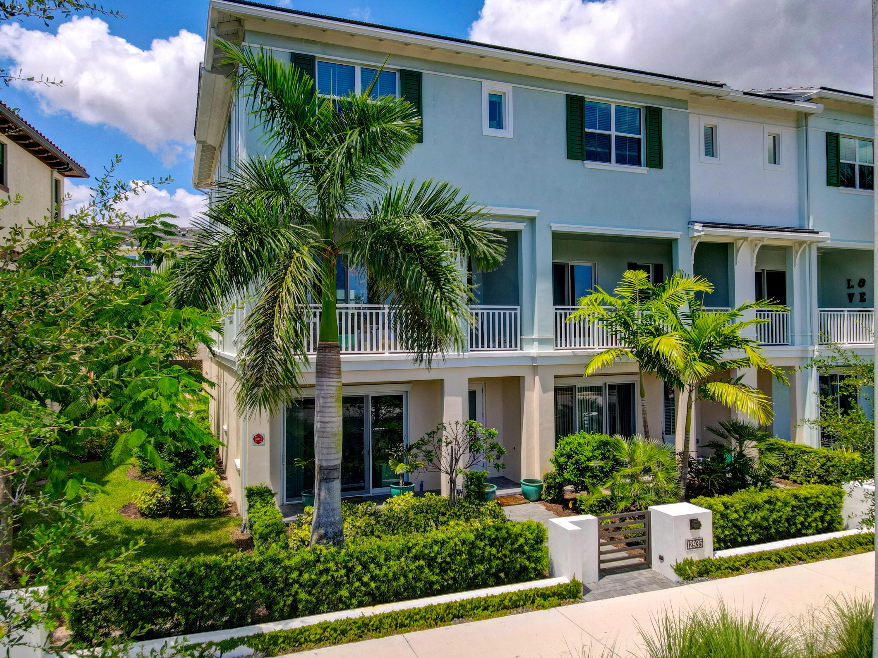 Fabulous END unit, lake view townhouse with high end upgrades throughout. UV light air sanitizing system, backsplash, under-kitchen cabinet lighting, wine cooler with extended kitchen counter/cabinets and double trash can cabinet. Upgraded floor to ceiling tiled bathroom  & fixtures & Toto toilets. Wood like Tiles in main area and gray color carpet in bedrooms. Rent includes upgraded window treatment, dimmable light fixtures, ceiling fans, security home alarm, pest control, AC maint, cable, internet and lawn care. 2 XL walk-in closets. Den and full bath on first fl. EXTREMELY low energy bills. Easy access to 95 & FL Turnpike. Few miles to PBI airport and beaches. WALKING distance to Benjamin High. Surrounded by golf courses. Spectacular clubhouse, basket ball court, fitness center & pool