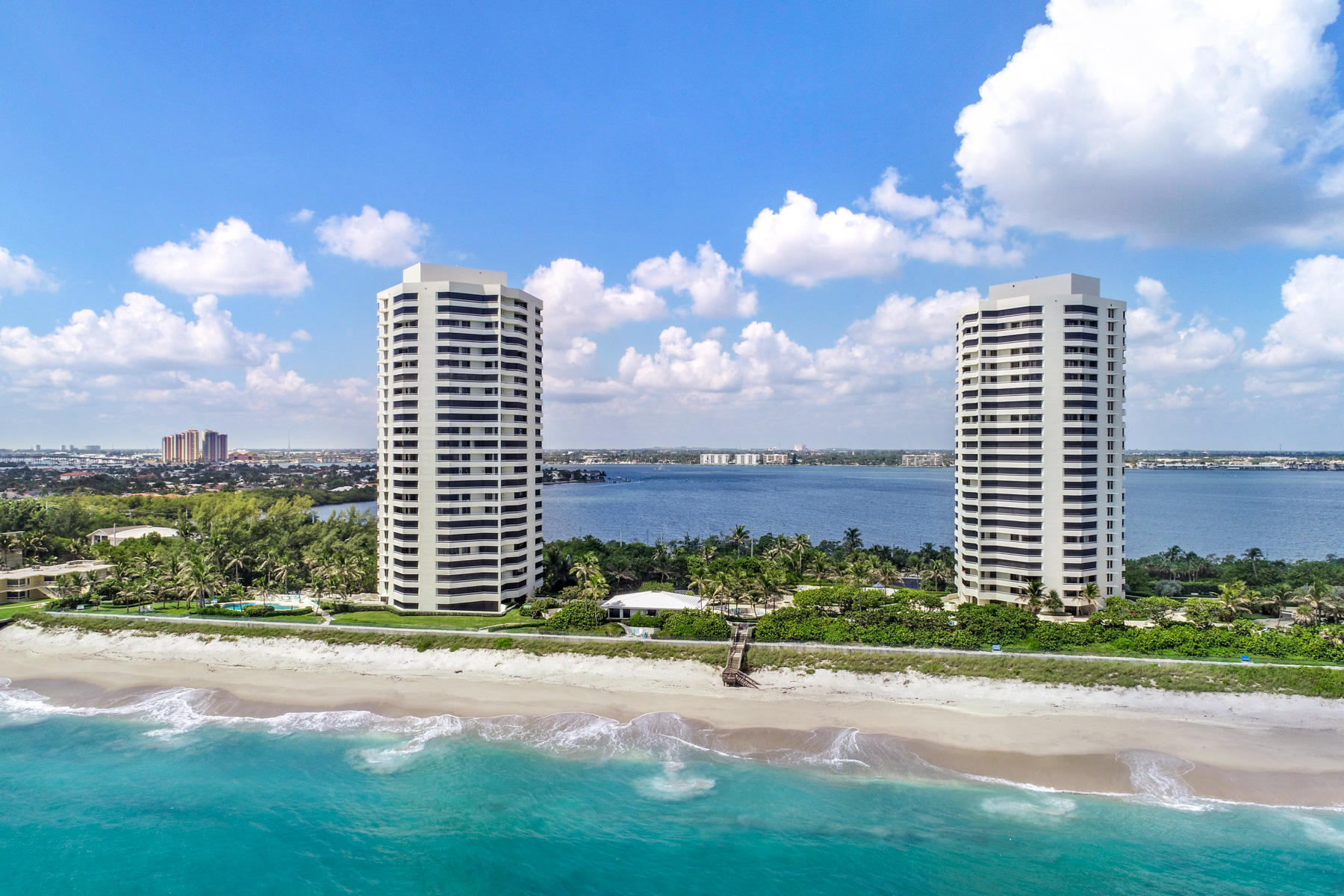 Outstanding views of the ocean and intracoastal waterway in this lovely 2/2 at Seawinds.  Light, bright and perfectly clean! Enjoy the sunrise in the morning from your double wrap around balconies, and the starlit nights and orange sunsets at night,  The ocean views are magnificent.  Being high enough in the building to look clearly to the bottom of the ocean, enables you to see all the marine life at the beach.  Kept in pristine condition, it shows like a dream.  Lovely white cabinets in the kitchen with Corian countertops,  white tile throughout the living areas.  An abundance of built ins. Two large bedrooms, en-suite laundry and tub,  and garage parking under the building. Electric vehicle charging stations are available.