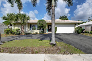 Front of ranch home located in Boca Square, Boca Raton, circular driveway