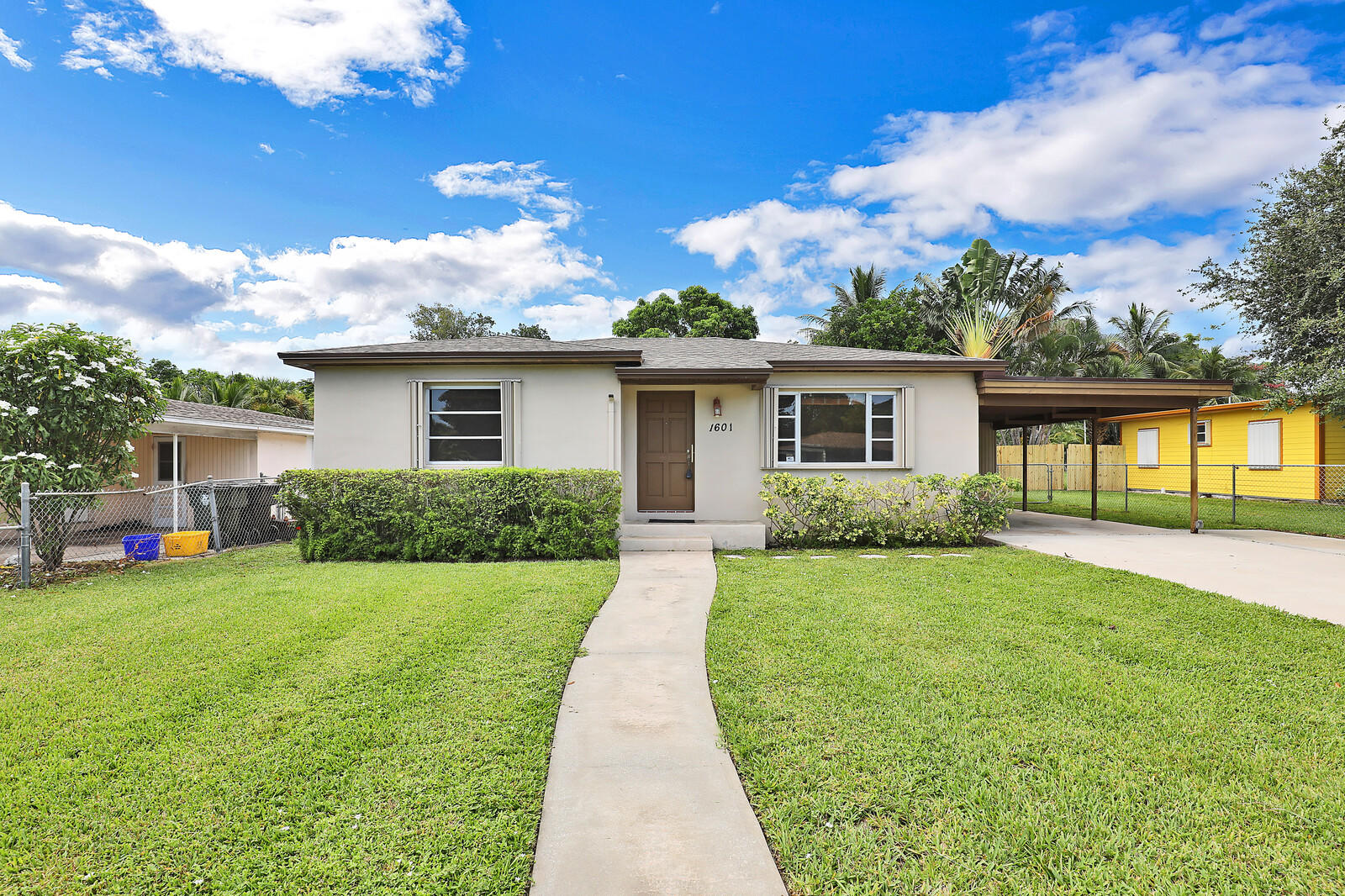 Don't miss this beautifully remodeled 2/1 charmer with carport in Lake Worth Heights! The home features CBS construction, 2021 roof, 2021 kitchen with high end solid wood cabinetry, granite tops, stainless appliances, and dimensional subway tile back splash.  The yellow oak floors have been restored to perfection and the fixtures have been recently updated.  On the mechanical side the home offers a 2019 HVAC system, updated electrical, and accordion hurricane shutters.  All of this and a beautifully manicured and oversized yard makes this house hard to beat.  Schedule your private tour today!