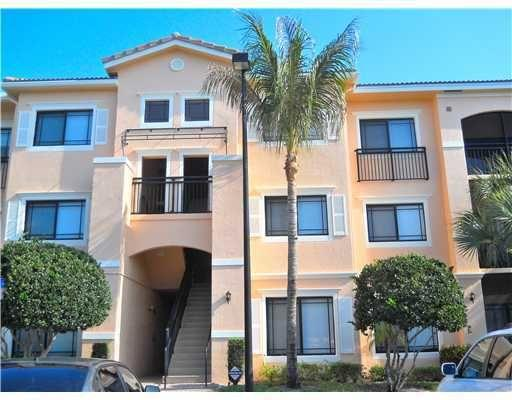This 2 bedroom 2 bath lakeside condo features tile floors throughout and peaceful views from both bedrooms and the living room. Huge walk in closet in the master, a seperate dining room and laundry room make this feel like home! San Matera is a gated community located behind the Gardens Mall, a stone's throw from Downtown at the Gardens and 10 minutes to everything else Gardens has to offer.