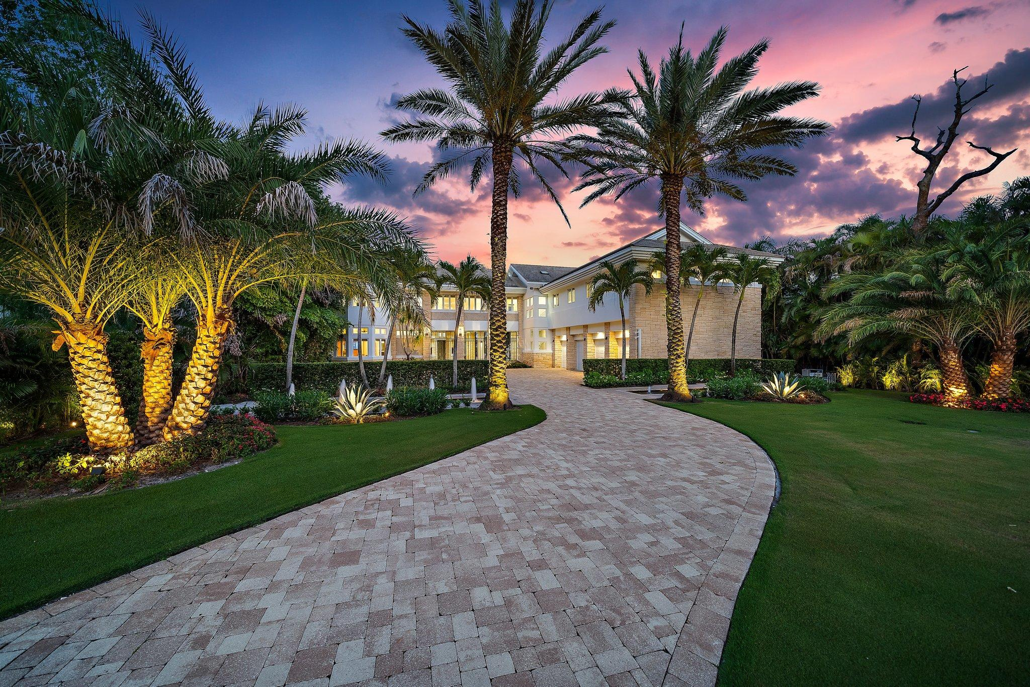 Stunning + palatial  modern Intracoastal home with over 9,300 interior SF and 106' of direct deepwater frontage!  Newly renovated to blend aesthetic simplicity w/ state of the art functionality this home offers a new approach to healthy living.  A private gate leads to this sprawling and lush 1.4 acre estate just minutes from the Jupiter inlet.  Organic design elements include marble + wood flooring, stone accent wall w/ fireplace and floor to ceiling windows (all premiere impact).  A 2 level living room welcomes you into this spacious home.  All rooms are grand in size, blending casual comfort + elegance.  Family room + kitchen w/ water views are the hub of this inviting home.  Owners suite offers resort luxury w/ spa style bath + massive closets.  Additional rooms include a huge home gym , a theater room, home office and a large pool cabana w/ kitchen.  Guest BR's are all grand in size and feature spa-like ensuite baths.   Entire upper floor enjoys a spacious outdoor lanai area with views of the pool and Intracoastal waterway, along with tropical breezes.   If laid back luxury is what you desire, this is the home for you.  From the enchanting (and private) manicured grounds to the incredible interior square footage and easy boating options, this Florida home has it all!  Beautifully located within minutes of best beaches, shopping, dining and golf venues, conveniently by the Palm Beach Gardens/Jupiter line.   Close to 3 major airports, Palm Beach Island... you will Love living here!