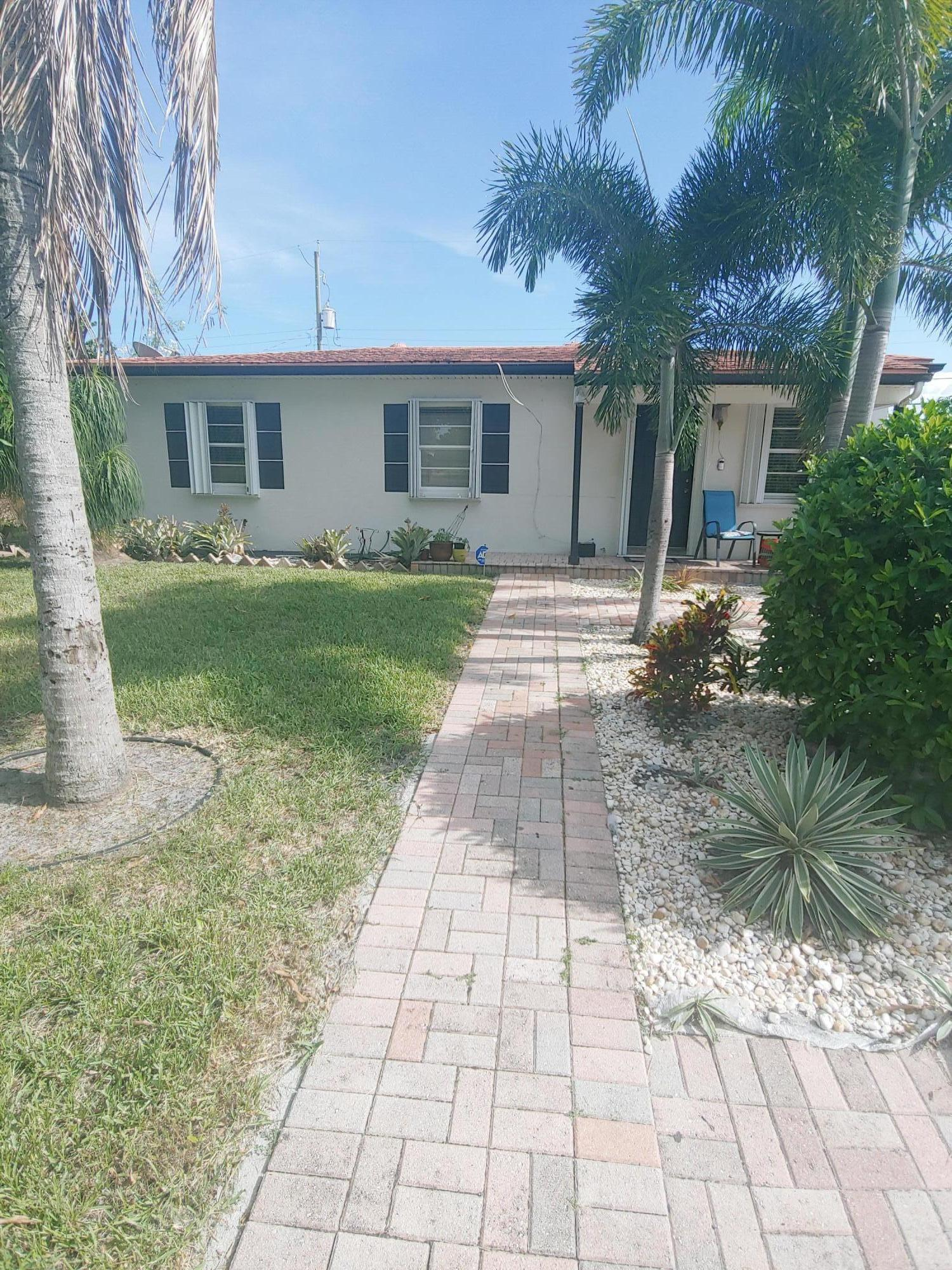 Home for sale in WHISPERING PALMS PL 5 IN Lake Worth Florida