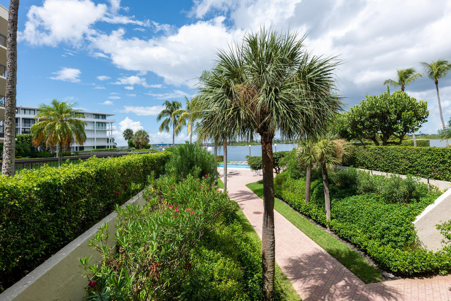 Sutton Place is the only Intracoastal condo in Palm Beach with garage parking priced under 2 million.This large corner 3 bedroom 3 bath unit has a wrap around balcony in a desirable full amenity building with 24 hr doorman, new gym, hallways and clubhouse on the pool deck. Gated deeded beach access gives owners the enjoyment of both ocean and intracoastal waterway to view the boating activity or play in the sand and surf. The Four Seasons resort and Spa is just across the street and restaurants, shopping and Par 3 Golf Course are within a walk or close drive. Parking spaces #4 garage and #2 open.