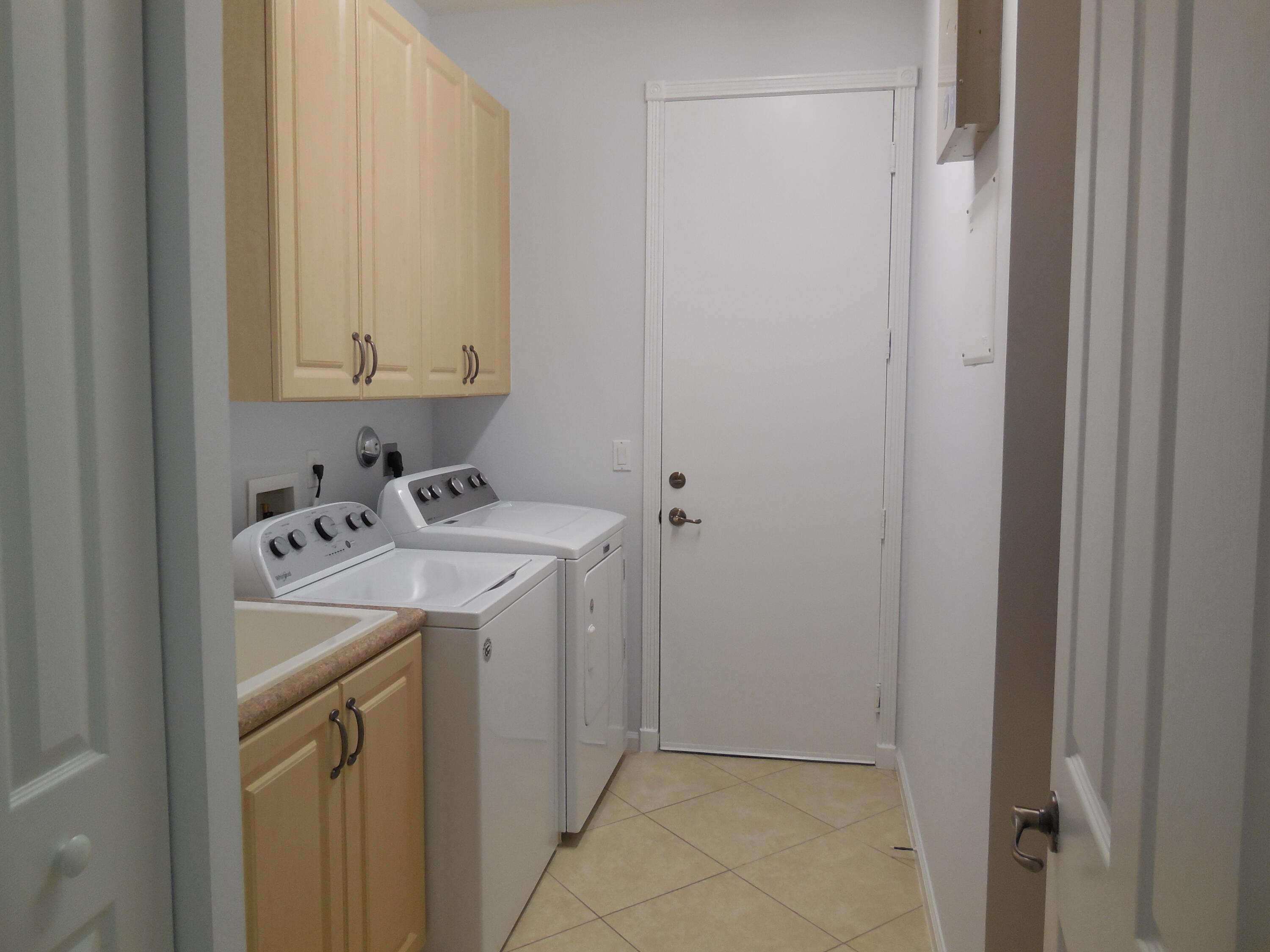 laundry area with sink
