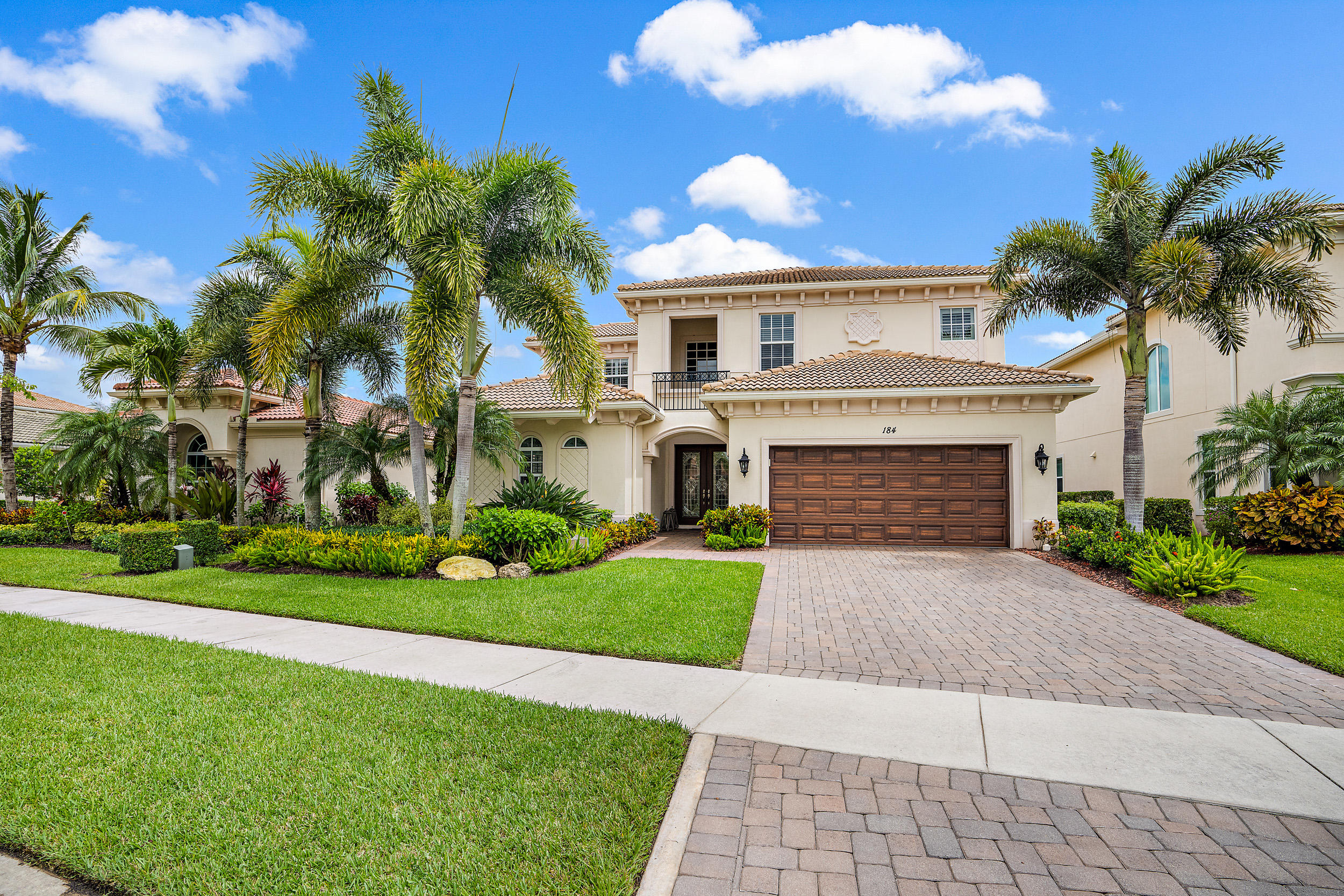 Desirable Santangelo model.  Screened heated pool and spa facing south. Fabulous covered outdoor kitchen and seating area with TV. Master Suite, one guest bedroom, and office on first floor. 2 Car air conditioned garage with epoxy floor is extended for easy golf cart storage. Home has new AC. Social membership required $3000 but golf membership available for only $5000 upfront fee.  Normally $25000.
