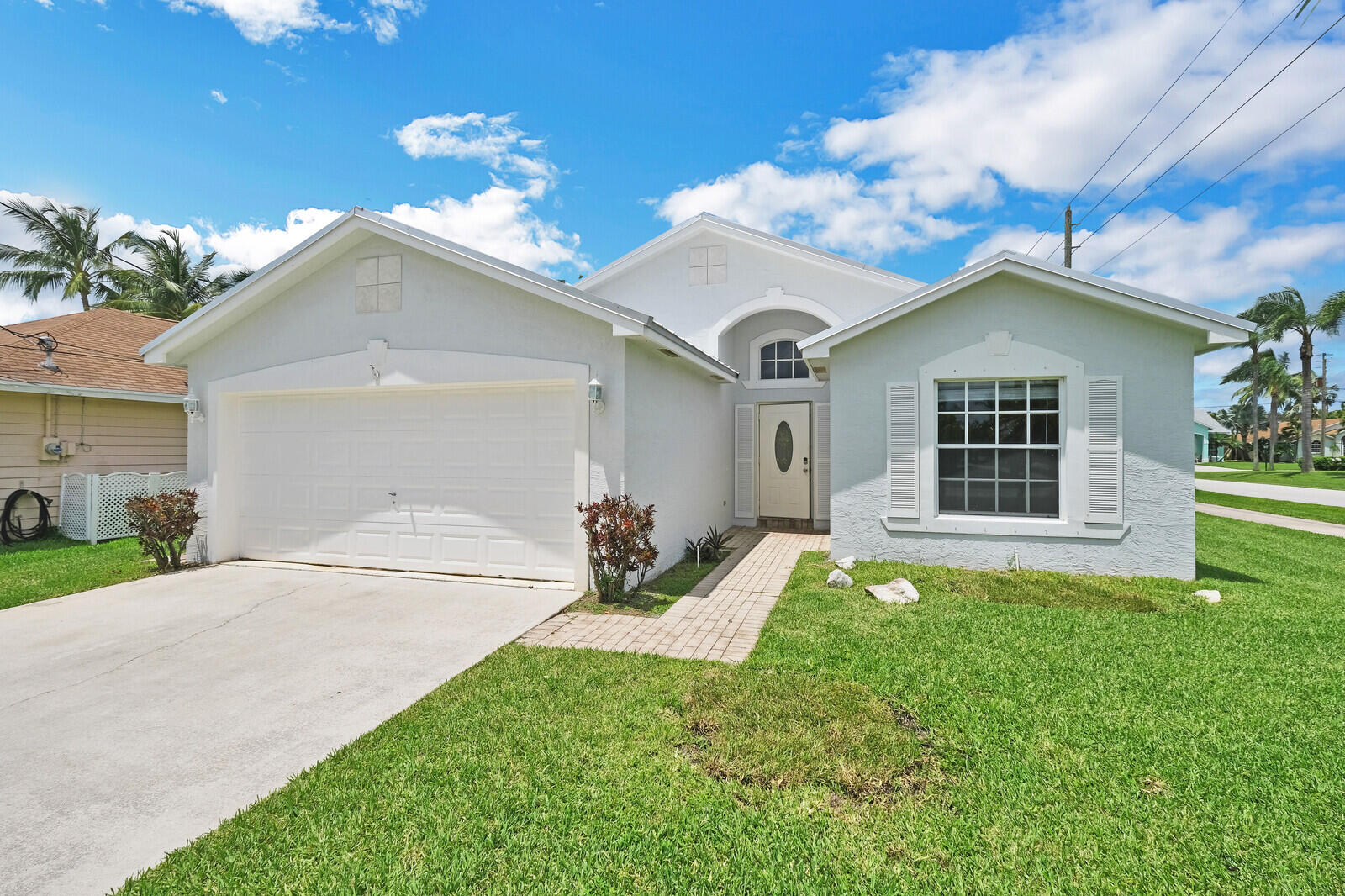 ABSOLUTELY CHARMING solid CBS built home  on a quite corner lot . Large bright eat-in kitchen with breakfast bar overlooking the pool.  Stainless steel appliances. Entry foyer and hallway leading to guest bedrooms and bath make this home appear larger than state living square footage. Master bedroom has ample closet space and master bath has shower and soaking tub. Fenced in yard. Plenty of room for your boat on side yard. Newer roof and freshly painted exterior. Great location just outside of Abacoa but with no HOA fees! Convenient to I95. All sizes approximate