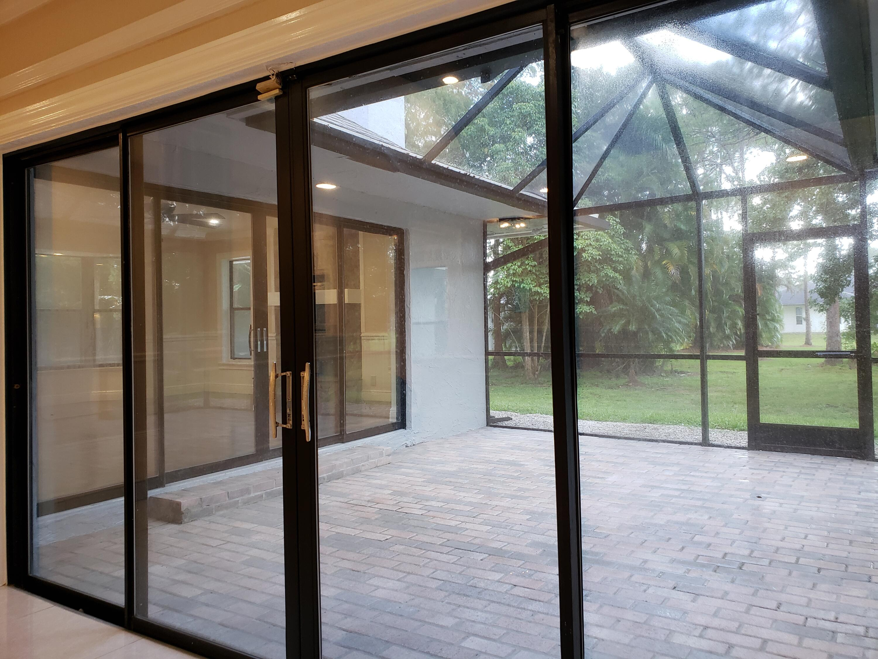 Living RM Sliders to Screened Porch