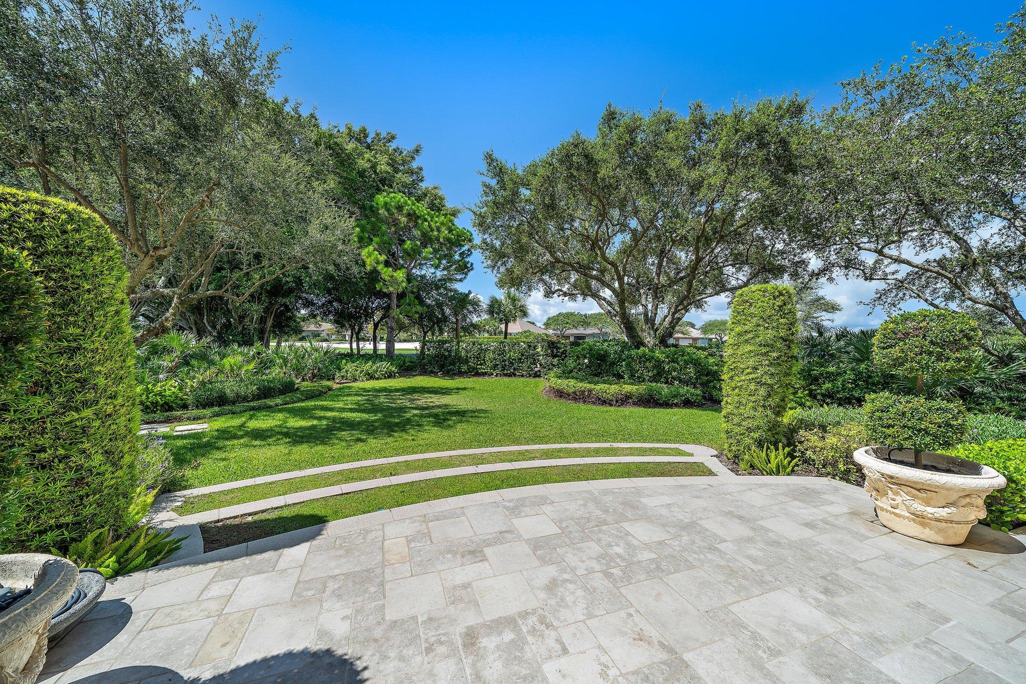 beautiful stone patio + backyard