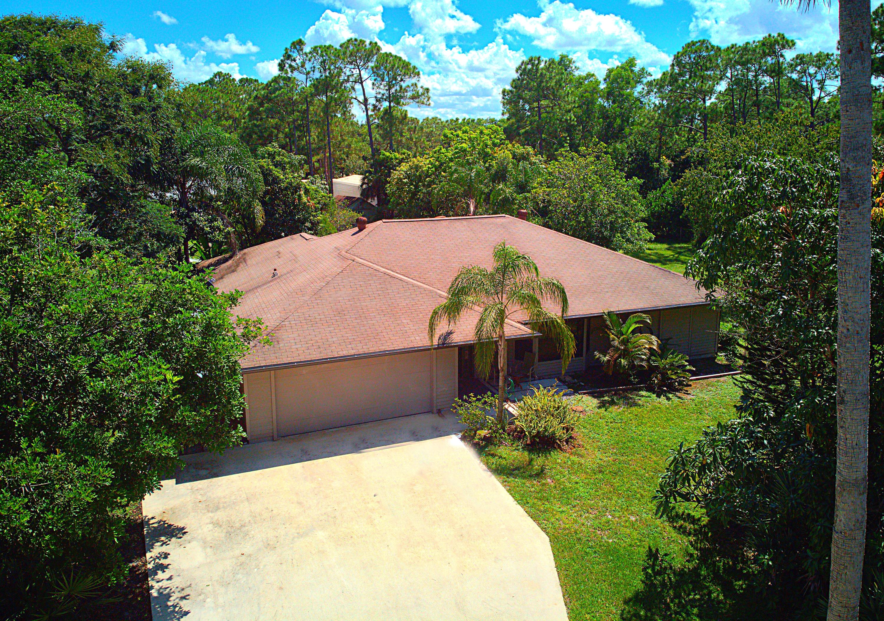 ESCAPE TO YOUR PRIVATE ISLAND OASIS! Amazing, private, salt water pool residence in Jupiter Farms with salt water softener. Kitchen all remodeled. Nestled on well over an acre of fruit trees and lush landscaping. Escape the hustle bustle in this SANCTUARY while taking a short ride to shopping, schools, turnpike , 95 and beaches. A+ rates schools RIVERBEND PARK! Hike, bike, canoe, kayak. All impact windows and doors! Dead end street, no through traffic.