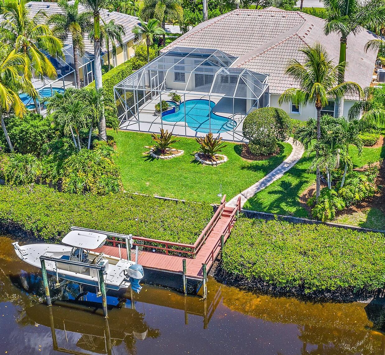 MUST RSVP FOR GATE ACCESS TO OPEN HOUSES Friday and Sat 12 to 3!! Totally Remodeled w/ Stunning Fixtures & Finishes Throughout! This Decorator Designed One Story Waterfront Home Is Located In The Exclusive Gated Community Loxahatchee Pointe. Some Features Include 4 Bedrooms Plus Office, 3 Full Bathrooms, 3 Car Garage, Screened In Patio w/ Covered  Lanai, Custom Pool & Spa, Impact Glass Doors, Beautiful Wood Floors, 95Ft Of Waterfrontage w/ No Fixed Bridges, 9,000Lb Boat Lift, Nice Size Yard, Gourmet Kitchen w/ Large Island, Gas Stove & Quartz Counter Tops, Butler Pantry w/ Wet Bar, NEW Roof  2021, Open / Split Floor Plan w/ Cathedral Ceilings & Plantation Shutters, Cabana Bath, Crown Molding, Epoxy Garage Floor, Paver Driveway, LOW County Taxes, A Rated Schools, Community Tennis & Basketball Court, Close To Great Restaurants, High End Shopping, Golf Courses, Amazing Fishing, Boating & Jupiter Beaches. Master Suite Has Access To Pool, 2 Walk In Closets w/ Built Ins, Private Water Closet, Double Sinks. This Is Florida Living At Its Finest!!