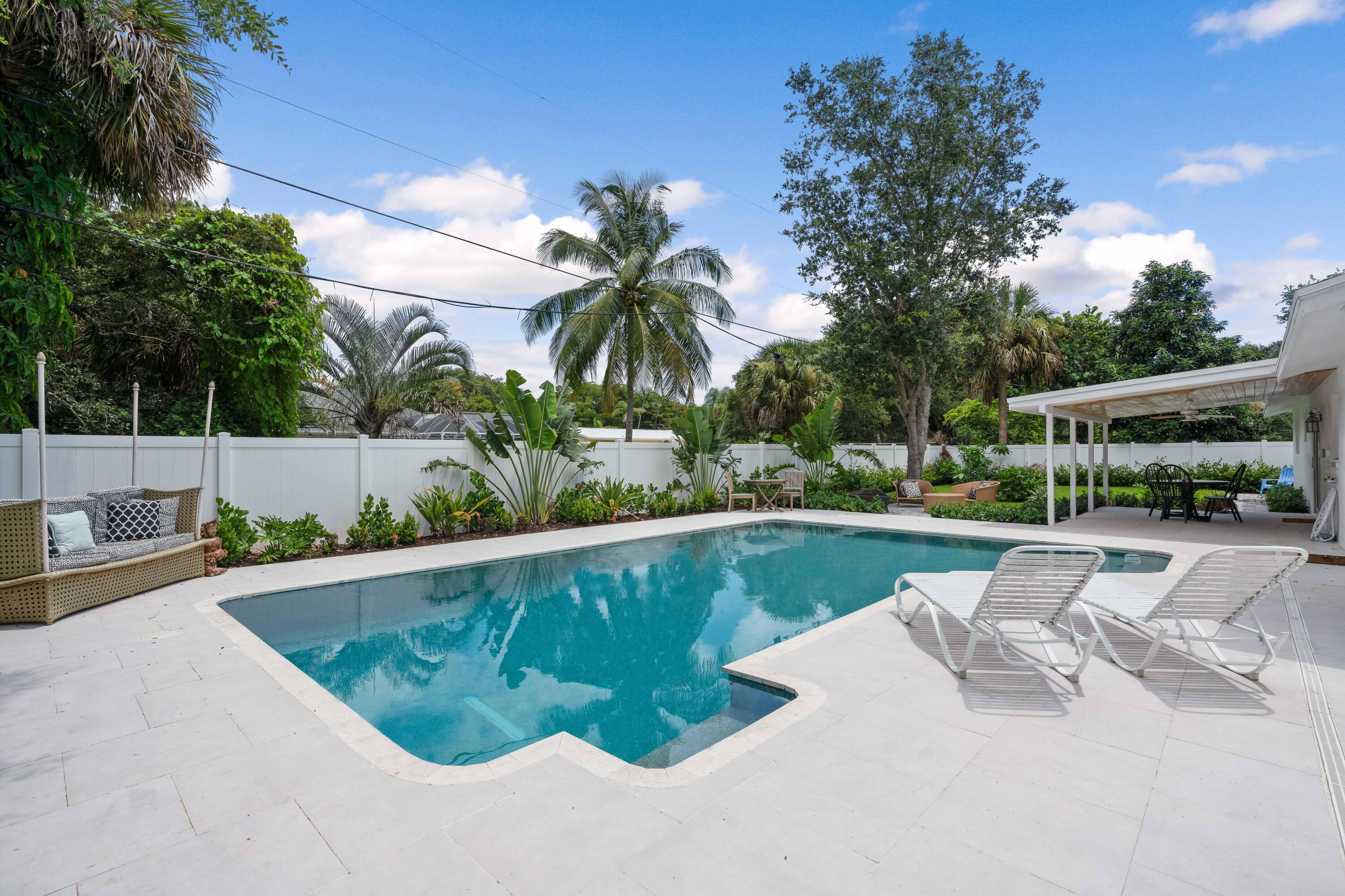 Available for two weeks - December 15 through January 1 for $5000, also available from April 10th on.      Entertaining is a breeze in this light and bright, beautifully renovated 3 bedroom, 2 bath house with pool and 2 car garage on an oversized lot. Close to Juno Beach. This home has a tropical backyard oasis. Come and enjoy this amazing opportunity to make this your own.   All of this located in close proximity to pristine beaches,  fine restaurants, entertainment, world class shopping and Palm Beach International Airport.