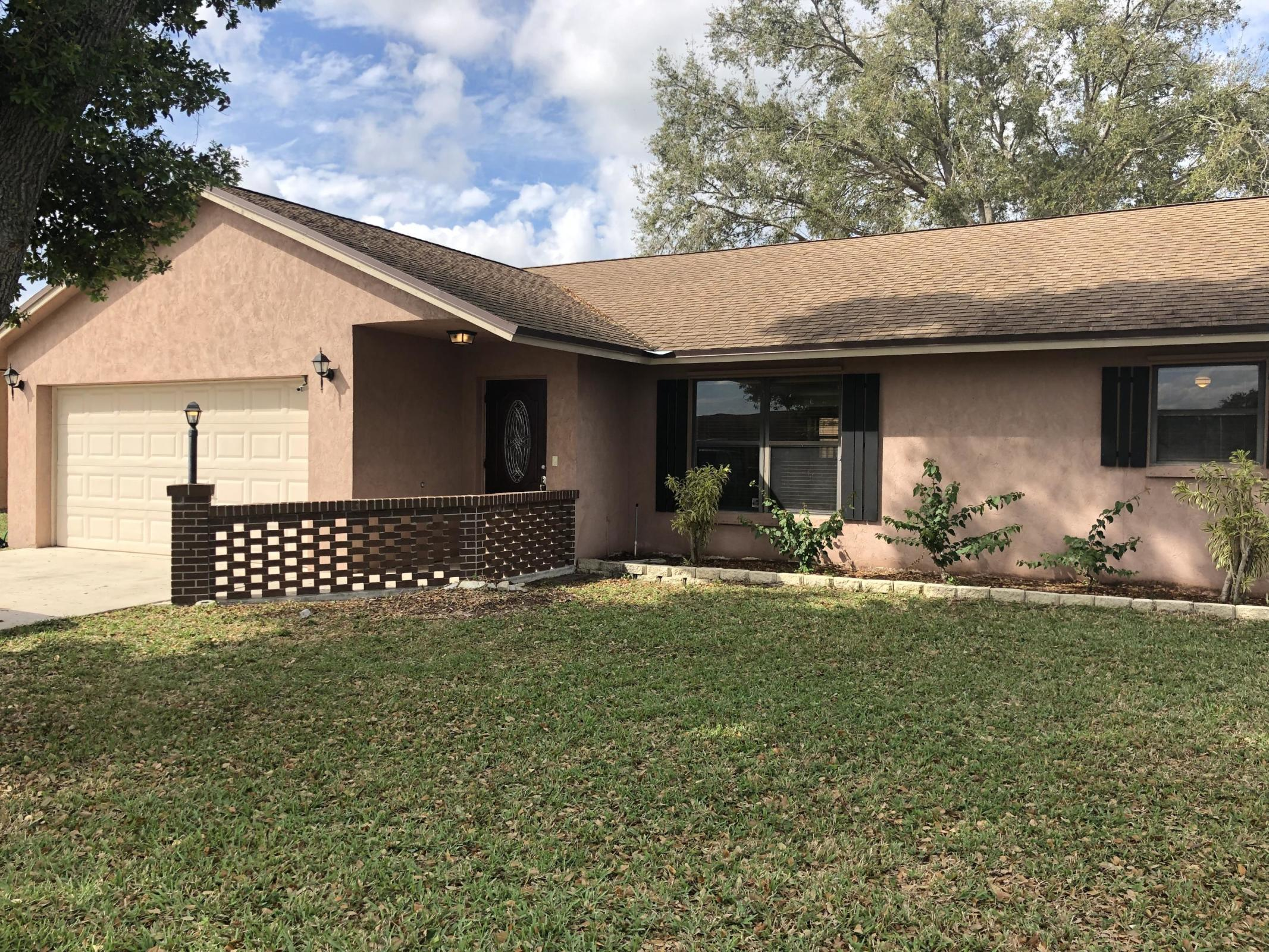 7605 Woodland Creek Lane Lake Worth, FL 33467