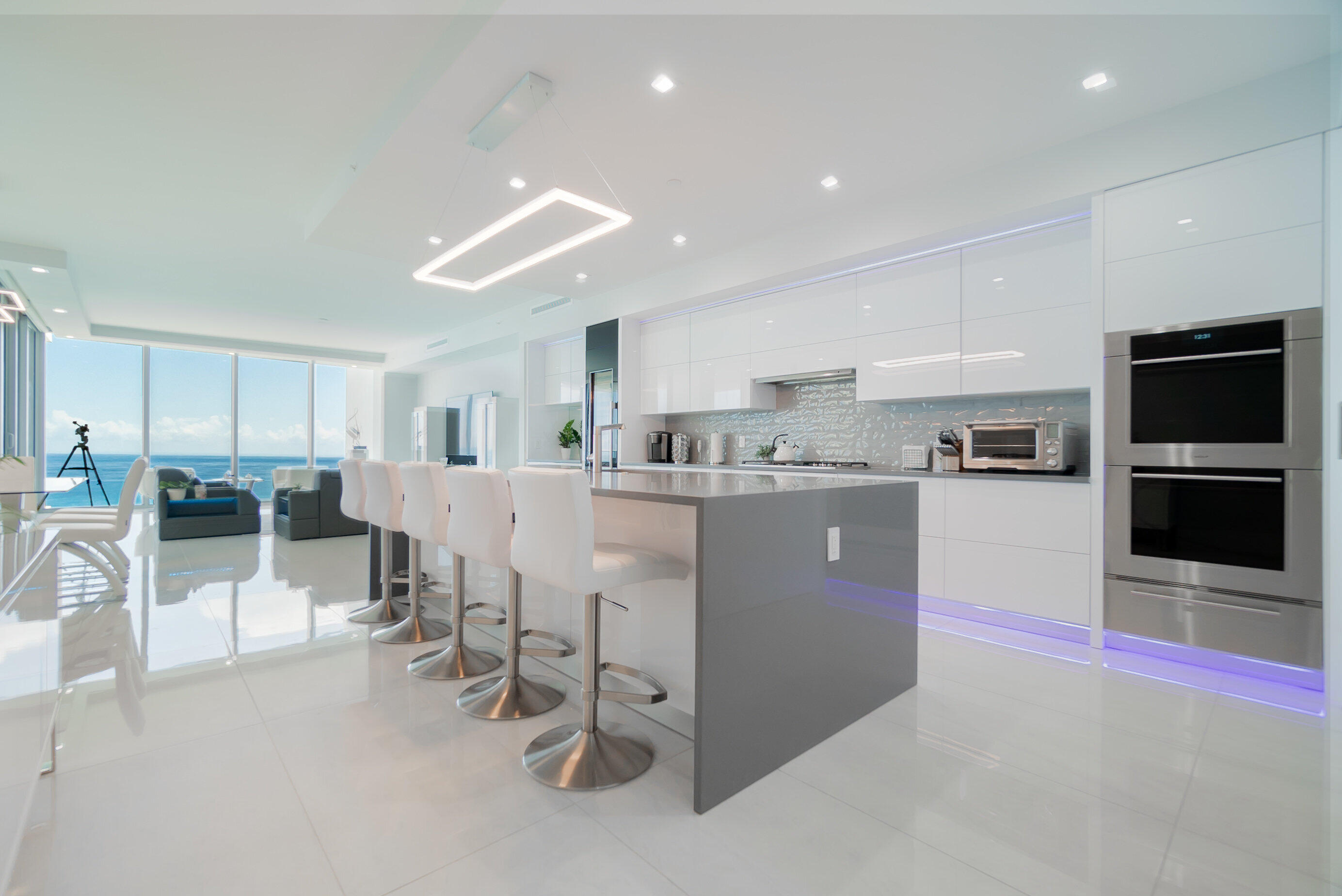 Live in the most luxurious boutique oceanfront building on Singer Island. No expenses were spared to upgrade the interior with high end finishes. The kitchen features solid wood, high gloss laminate finish cabinets with Electronic Auto Touch mechanism. Kitchen, baths and laundry room feature slate colored quartz counters to compliment the white cabinetry. All closets and the extra large pantry were upgraded with custom built-in cabinetry. Remote control window shades throughout the condo. Stainless Steel & glass barn door to the family/game room with short throw projection TV with Sonos surround entertainment system. The Control 4 Smart Home System allows you to adjust music, ac, window shades and more from your mobile phone. Video tour of Condo: https://www.youtube.com/embed/2QS2CF9zBEA