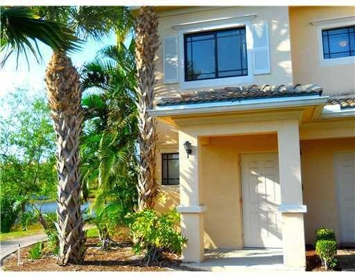 Peaceful water views from almost every room in this 3 bedroom, 2 bath unit in San Matera. Condo freshly painted and tiled throughout. Outstanding staircase. 2nd floor living with a 1st floor entry overlooking the bridge, most spectacular views in the community! Easy access to I95, the Gardens Mall, Downtown at the Gardens, nightlife and restaurants! 10 minutes to the beach!