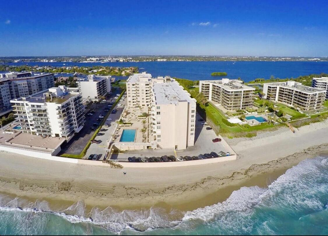Very Spacious 1 BR, 1.5 BA condo on the amenity level w/ Intracoastal & garden views. Move in Ready for your permanent residence or Beach Getaway! Enjoy the sunsets in this unit conveniently located on the same floor as the pool & beach deck. This condo has been tastefully remodeled w/ wood flooring in the living areas, maple cabinetry & stainless appliances in the kitchen and a room divider in the living room to give your guests & yourself more privacy. The condo has 1,008 total Sq ft of living space + the balcony, a storage unit & rare deeded covered parking. Also it is equipped w/ surround sound audio system. Impact Glass. The Patrician is a full amenity oceanfront building with a 24 Hour Door person, Pool & BBQ on the Ocean deck, Fitness Center, Clubroom! Live as if you are on vacation