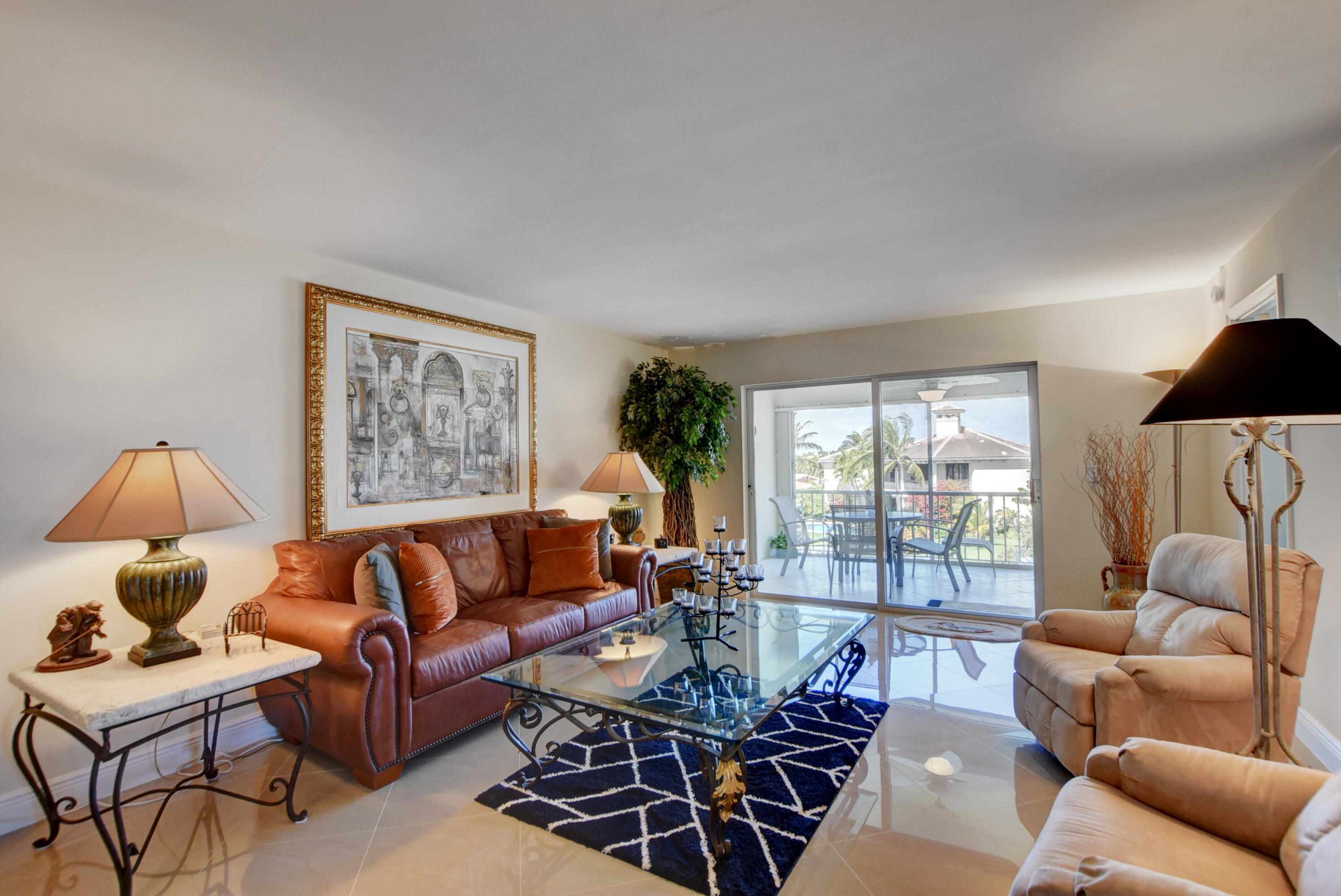 2 LARGE BEDROOMS PLUS A LARGE DEN  OVERLOOKING THE MARINA AND YOUR 25 FOOT BOAT SLIP . ALL PORCELAIN TILE FLOORS,UPGRADED FURNITURE,EAT IN KITCHEN ,WASHER AND DRYER IN UNIT. THIS UNIT IS RENTED UNTIL 9/30/22 @ $ 2600.00 PER MONTH WITH A $ 22,300.00 NET PROFITOLYMPIC SIZE POOL ,CLUBHOUSE,TENNIS ,BBQ AREA, SCUFFLE BOARD,STEPS TO BEACH AND POOL. 55 AND OVER VERY SOCIAL COMPLEX. OWNER WILL FINANCE