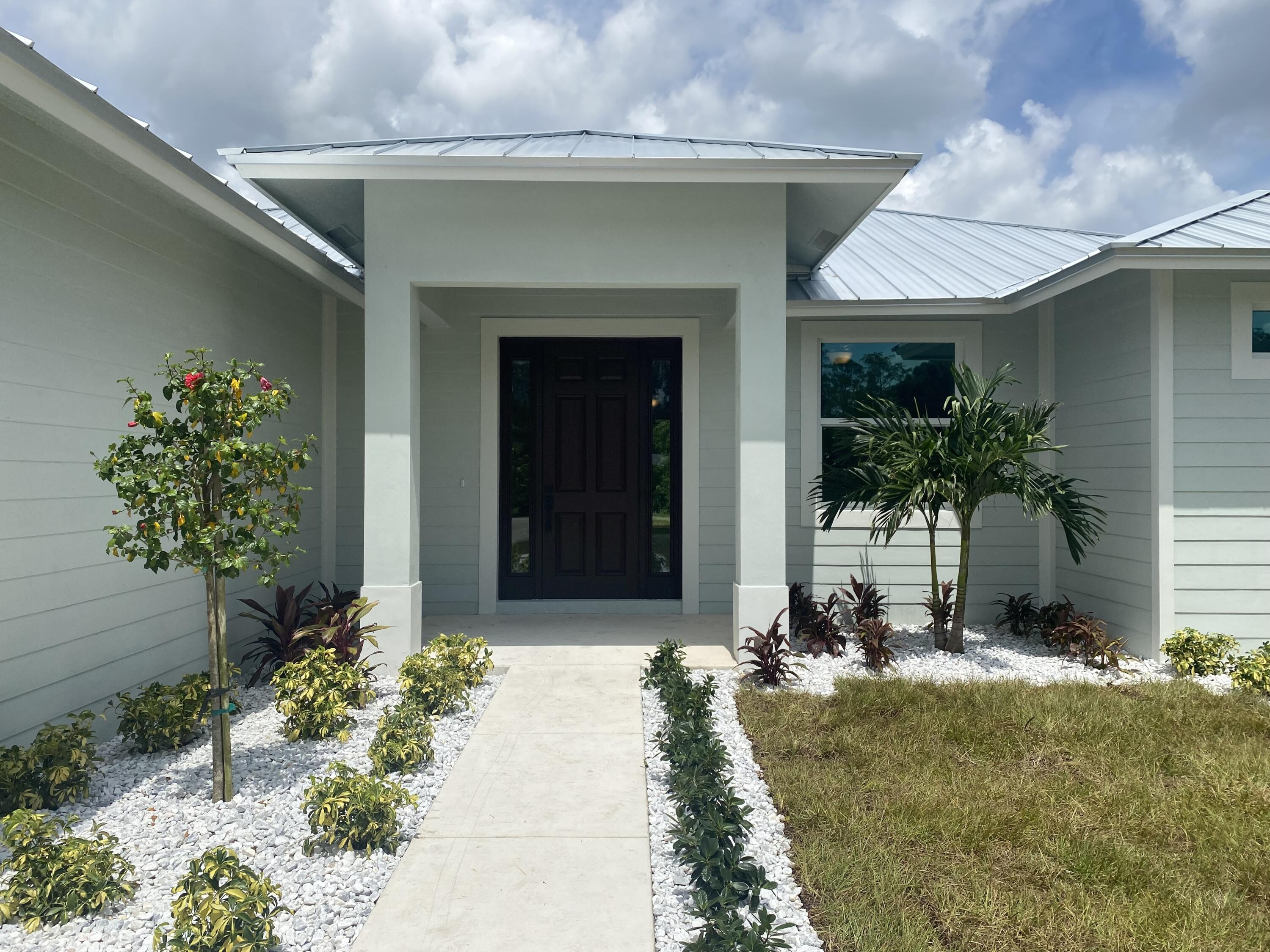This brand-new construction home is MOVE IN READY!! It boasts a contemporary feel while also adding warmth with outstanding flow between the main living areas & the spacious covered lanai. Inside, the great room & dining room showcases decorative tray ceiling accents, French & sliding glass doors to the lanai & total openness to the island kitchen with quartz counter tops, custom cabinetry, top of the line appliances, & pantry. The den & half bath is adjacent to the great room. The private master suite incl., a tray ceiling, French doors to the lanai, a plush bath & walk-in closets. There are 2 additional bedrooms with a guest bath. Other features incl. Hurricane impact doors & windows, seamless metal roof, eight-foot doors throughout.