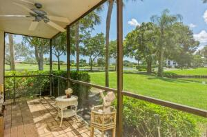Spectacular golf, lake & green space views from this corner unit!