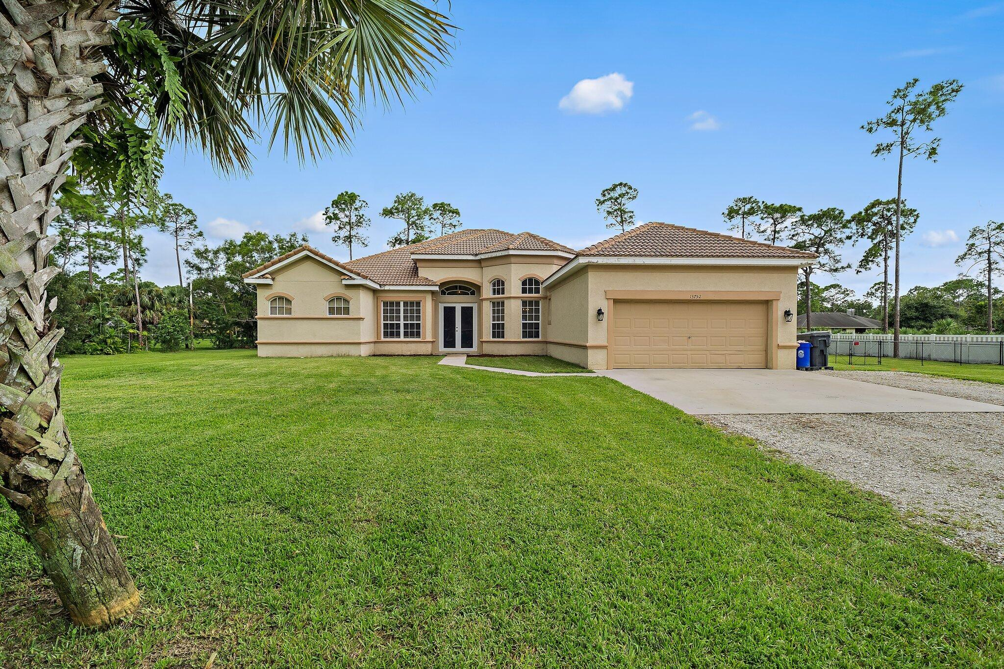 Home for sale in The Acreage, Loxahatchee, Royal Palm Beach Acreage West Palm Beach Florida