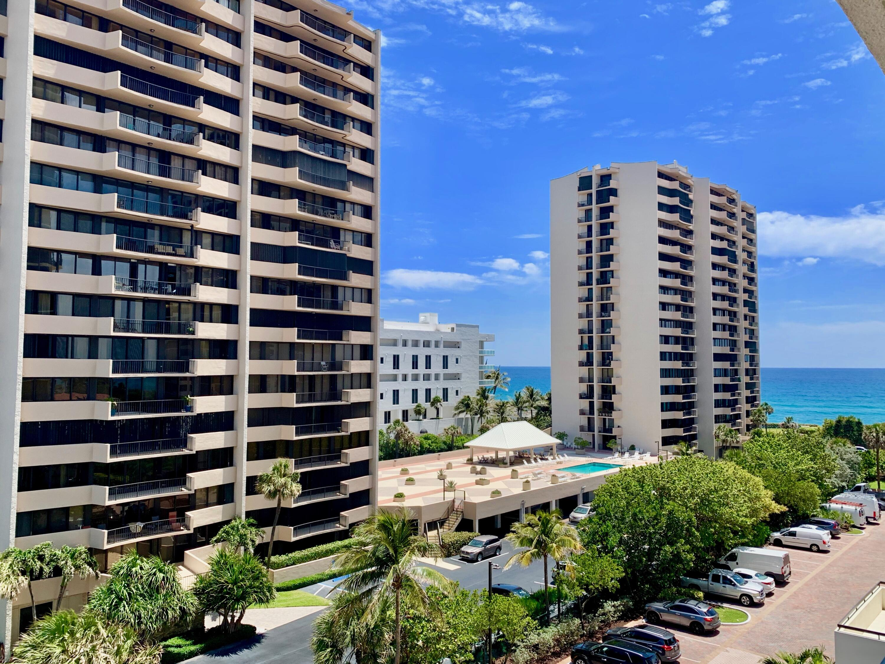 COMPLETELY REMODELED 2BR 2BA oceanfront condo with all tile flooring, newer appliances + AC. PLUS ALL IMPACT GLASS Sliding Doors and Covered garage parking space #205. Interior full size laundry room. Storage Locker #85 lobby. South facing balcony off living areas and master BR plus bonus balcony over pool deck off kitchen area. Enjoy the split bedroom spacious and open floor plan. Cote D'Azur is located mid Singer Island and features 2 Towers, unmanned security gate, tennis courts, heated pool and elevated deck, fitness facilities with sauna, library meeting room, beach walkover to the beautiful freeform Singer Island beaches. Rentals OK Year 1 - 2x per year, 90 day minimum. On Site management and maintenance staff. QUALITY CONDO with low overhead compared to other oceanfront condos.