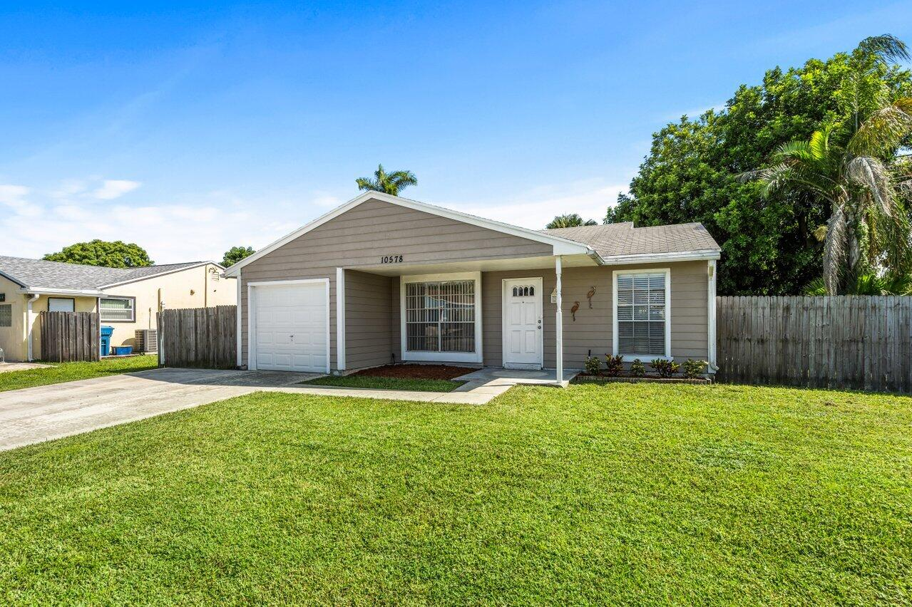 Home for sale in COUNTERPOINT ESTATES 7 Royal Palm Beach Florida