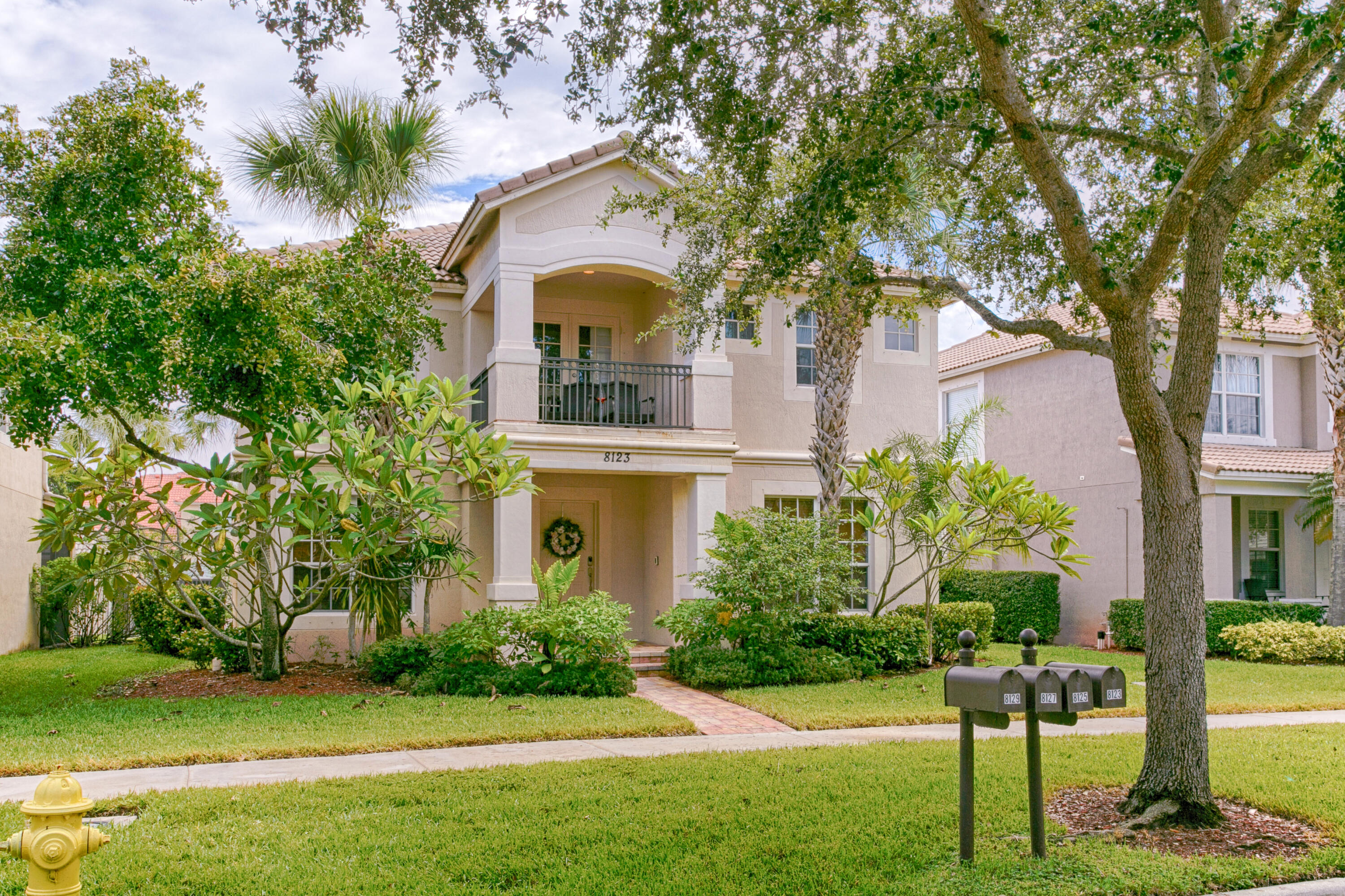 Welcome to Florida in this gated community in Palm Beach Gardens. This seasonal two-story home offers 4 BR's/ 2.5 baths & a downstairs office or den. This home has been recently renovated & decorated to have a relaxing beach feel. Enjoy cooking in  this large eat in kitchen. Relax in the FR/ with newly installed beautiful vinyl plank flooring throughout the entire downstairs living area. Formal DR, plenty of storage and the house has been freshly painted. The upstairs master suite has walk in closets, dual sinks, a large tub & separate shower & its own private balcony. The other 3 upstairs bedrooms are large and share 1 bathroom. The home offers a covered  patio, small yard with a detached 2 car garage and extra parking also.  Community pool, close to shopping, dining and entertainment.
