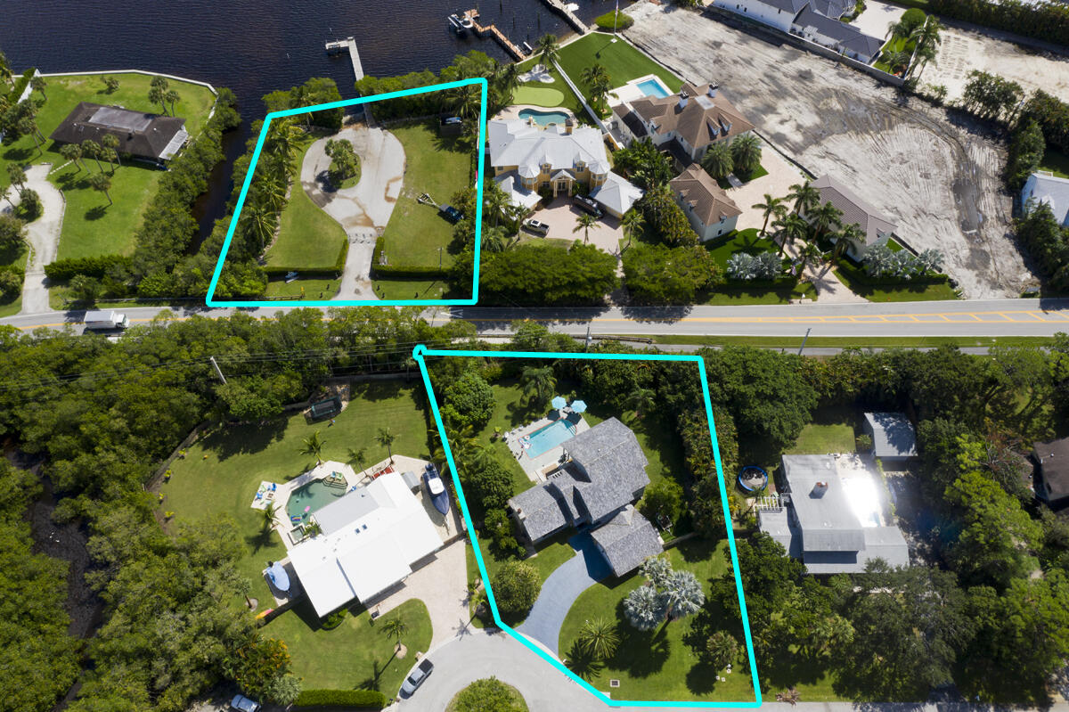 Boating enthusiasts, the ''Jup Life'' awaits you in this truly one of a kind home in the family friendly community of Eagles Nest boasting a private community boat launch and dock directly across the street on the Loxahatchee River, just minutes to the Jupiter Inlet and Atlantic Ocean!  Enjoy morning sunrises facing east with water views from both floors!  This unique home is the largest of only 98 homes in the community and one of only two homes with water views.  Originally built for the developer, it sits high on a cul-de-sac on 1/2 acre with a large, tropically landscaped private backyard with pool and patio, perfect for entertaining.  Large rooms and spaces with cedar lined vaulted ceilings and stone fireplace.  Newly upgraded, open kitchen with granite countertops and stainless steel appliances overlooking an expansive living room and sliding doors leading out to the covered deck and pool area.  The Eagles Nest community is a family friendly, boaters paradise with very low HOA neighboring Pennock Point and multi-million dollar homes.  Bring your paddle boards and kayaks and for the avid boater - you're just minutes to the Jupiter Lighthouse, a dozen waterfront restaurant and tiki bars, numerous sandbars and head east less than 60 miles to Freeport, Grand Bahama Island where you will truly be on Island Time - there's too much to share, this home is a must see to understand the lifestyle that awaits you!
