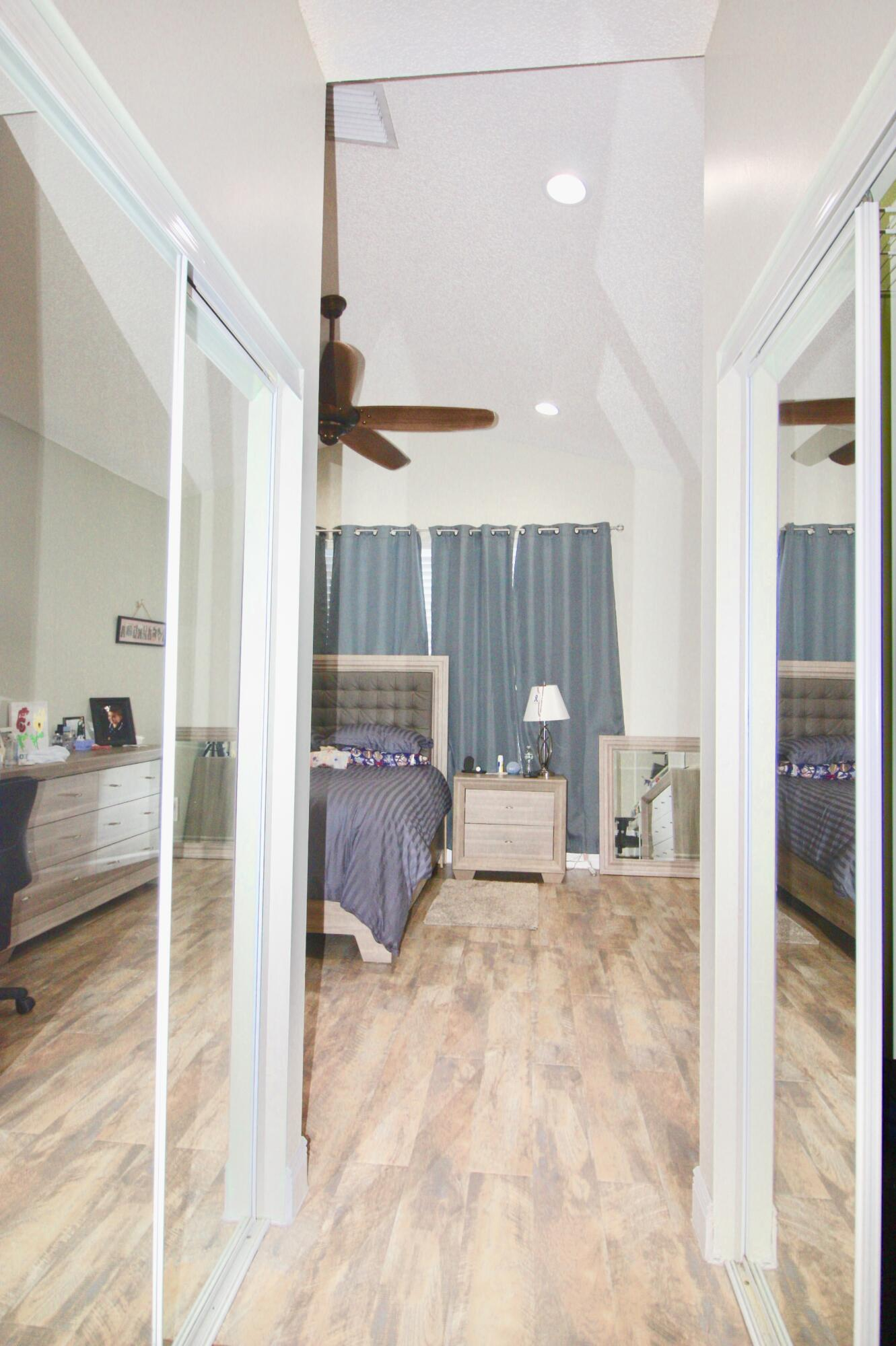 DUAL WALK-IN CLOSETS WITH MIRRORS