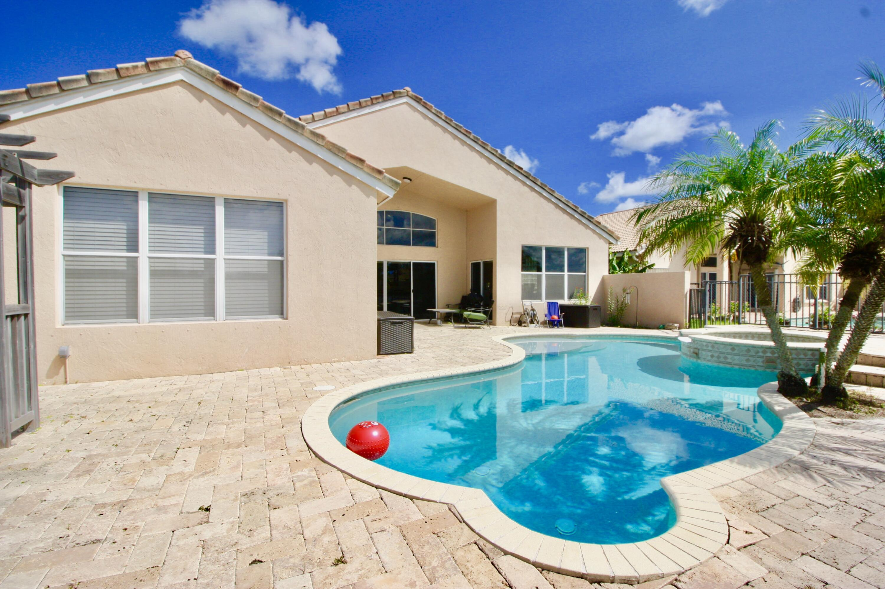 ENTERTAINING IS FUN WITH THIS POOL AREA!