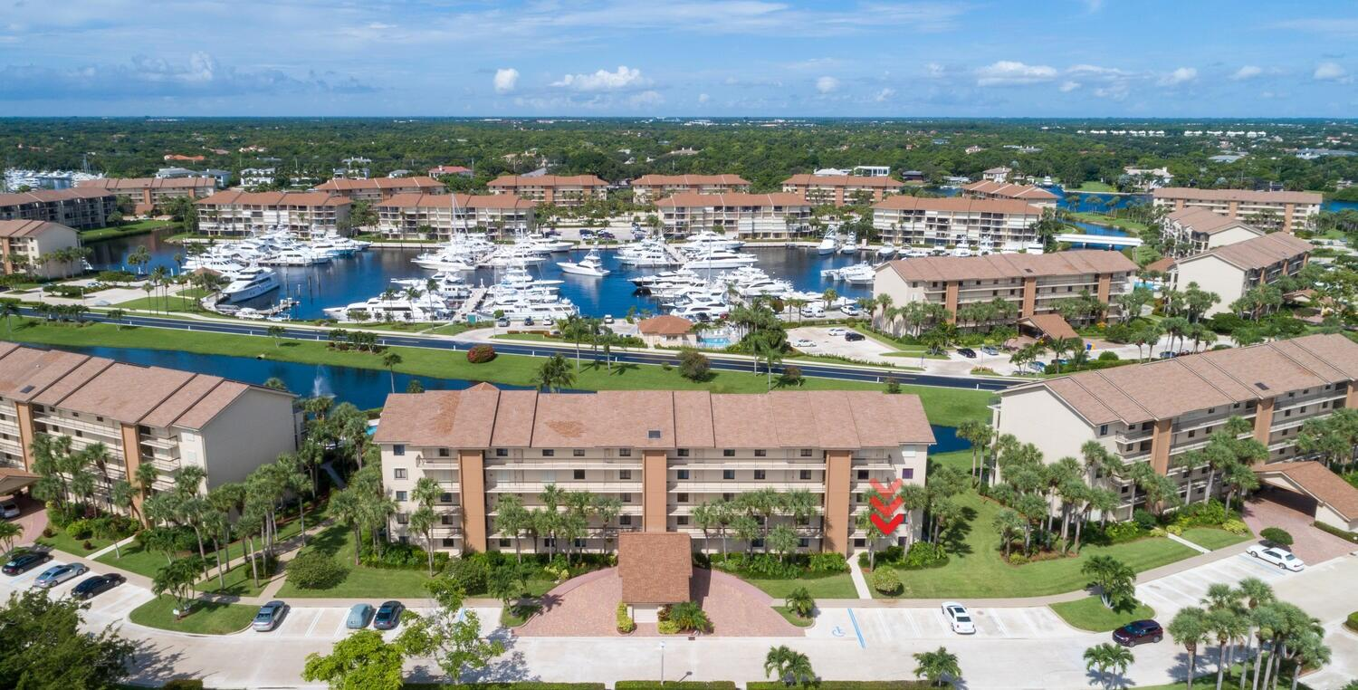 Rare corner unit with lake and marina views! This desirable 1st-floor corner unit provides a private entrance and the ease of walking out the back patio to the pool with views of the lake and marina. The updated dA(c)cor reflects the coastal living of Jupiter, FL.  Locate on the Intercoastal Waterway less than a mile from blue waters of the Atlantic Ocean, supermarket, pharmacy, restaurants, and the Juno Beach Pier. The community built by Berg & DiVosta is known for its quality build developments. Amenities include four pools, each having its own clubhouse. Tennis Courts, Bocce Ball court, Picnic Tables w/ BBQ's. Schedule a private showing today.