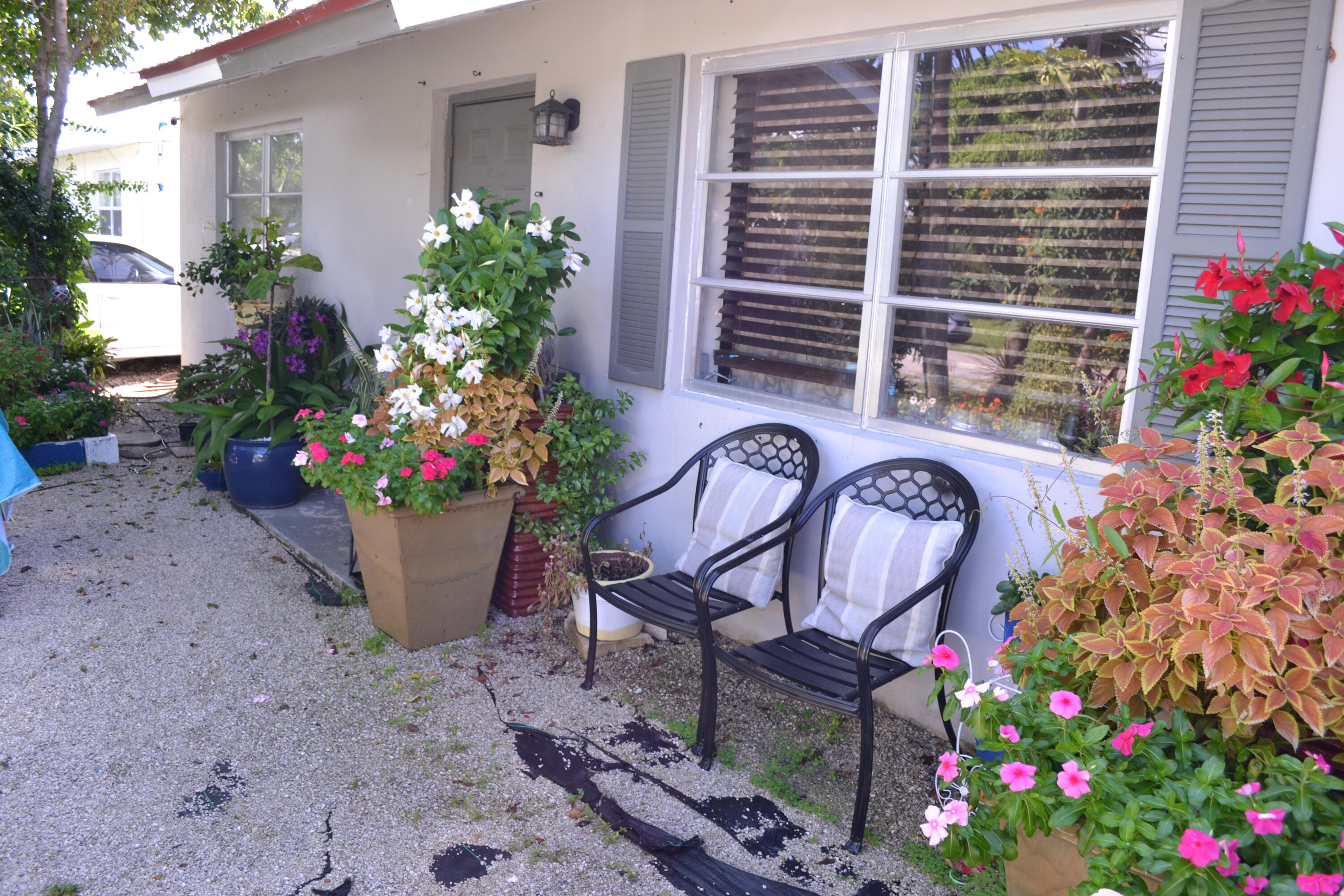 3 bedroom, 1 bath CBS home with carport, metal roof just one year old and a beautiful green backyard in the heart of Jupiter. Tenant in place and would like to stay.Great investment