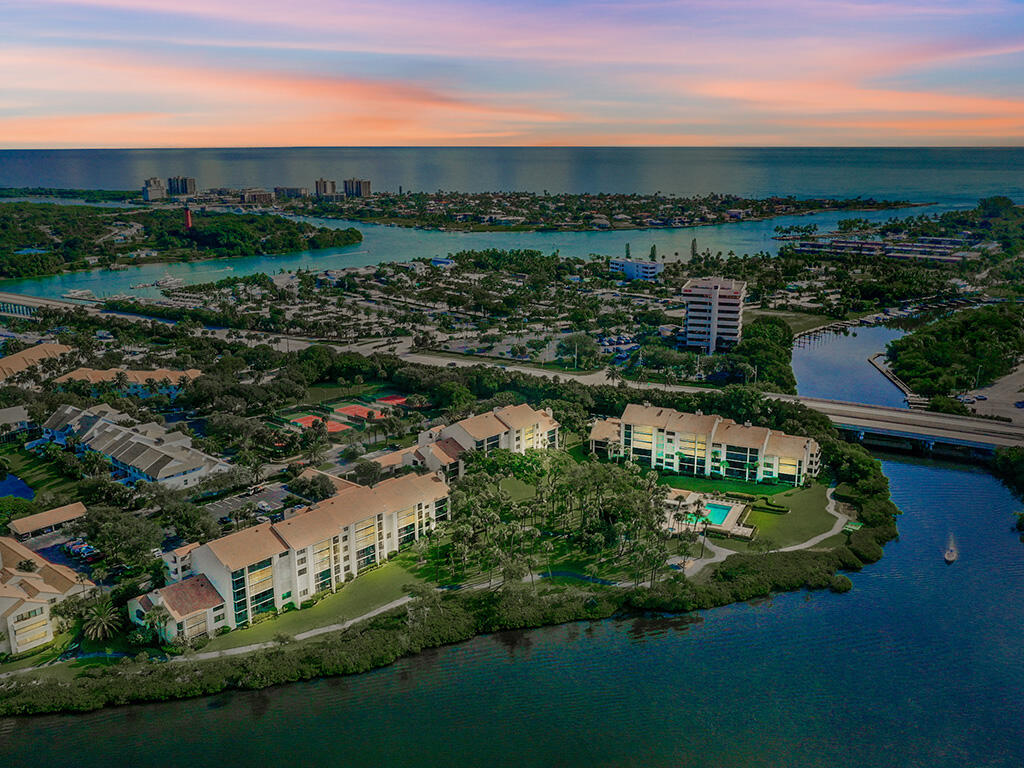 Surround yourself in luxury with this 3 BR, 2.5 BA ground floor, corner unit condo offering over 2,060 SF of living in the exclusive Jupiter Harbour community.  Condo has been completely updated and remodeled throughout with a West Indies flare and a user friendly design in mind.  Updates include recessed coffered ceiling's, custom kitchen and bath's, commercial styled appliances, exotic quartz countertops, luxury flooring, custom built valances and crown molding throughout and surrounded by lush garden landscapes and intracoastal water views. Located in the heart of Jupiter you can find world class fishing, boating, beaches, water sports, and only a short walk to an array of Dining, Shopping and Entertainment.All measurements approximate, buyer to verify.