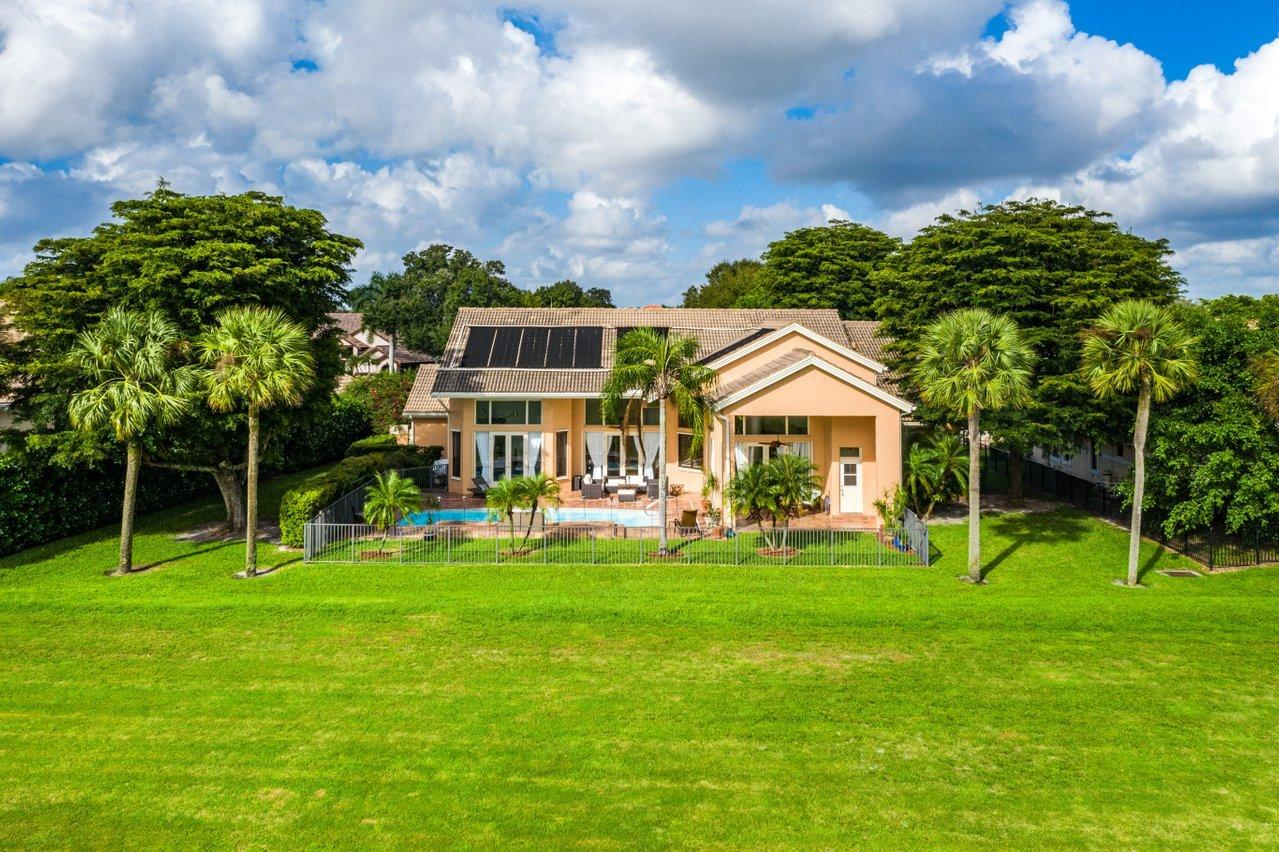 Pool home with golf course views
