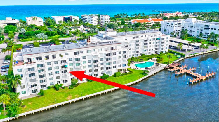 DIRECT WATERFRONT VIEWS sunsets and sailboats on the Intracoastal Waterway with deeded beach access. Why just look at the boats going by? This complex also has a BOAT DOCK that owners may lease! This units has had a quality renovation which includes IMPACT GLASS, tile flooring, popcorn removal and brand new carpet in the bedroom.  Newer A/C 2018. Right across the street is the amazing Four Seasons Hotel with several lovely restaurants. This unit is move-in ready and the furniture is negotiable.