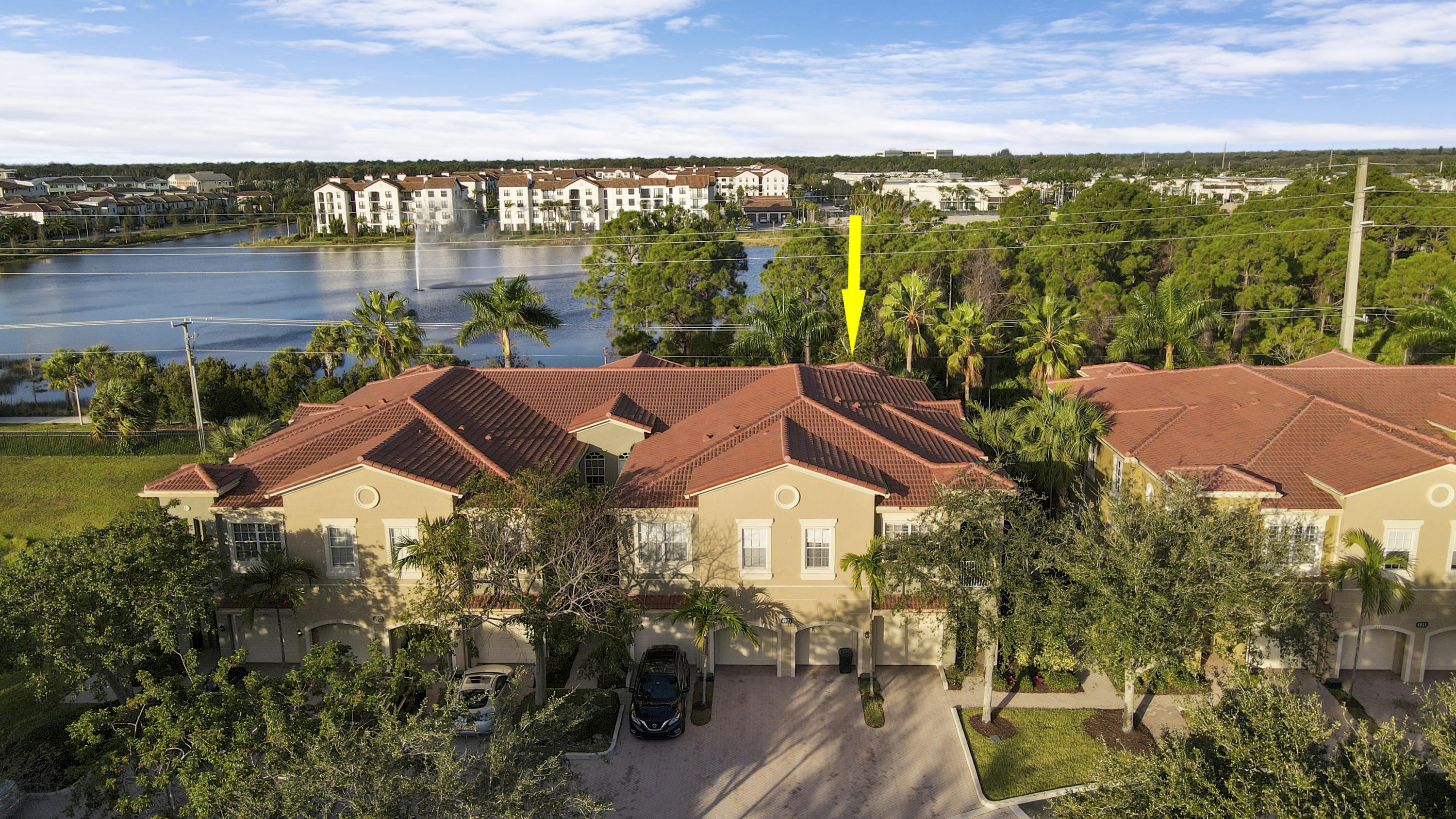 Ideally located with direct lakeside path to Alton & down the street from Abacoa Town Center, this top floor condo (2nd level with stairs) has pristine sunset & water views. This open floor plan has a balcony and has just been repainted and thoroughly cleaned. The condo offers two bedrooms and a full den that can be a third bedroom, two bathrooms, a laundry closet with side-by-side machines and private garage with additional private & guest parking. The gated community has a pool and gives direct pedestrian access to Alton for all the shopping, restaurants, entertainment and gym . Easy access to the beach, I95 and the turnpike, Palm Beach Gardens, Jupiter & Juno Beach. Landlord willing to replace main living carpet area, except stairs, with vinyl flooring for $2,495/month rental fee.
