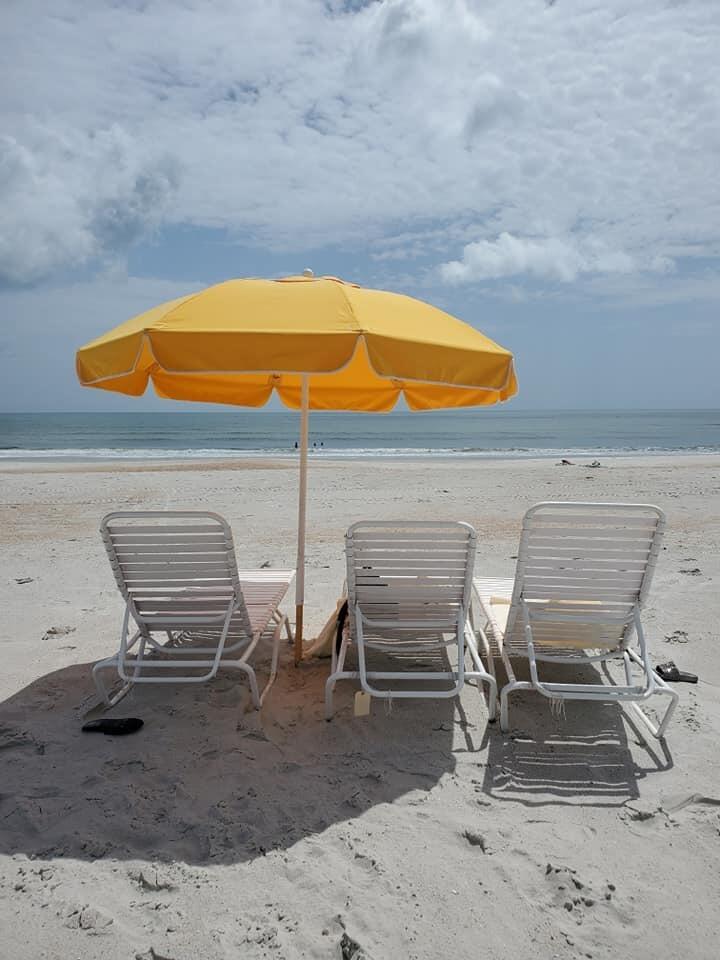 beach and umbrella sceen