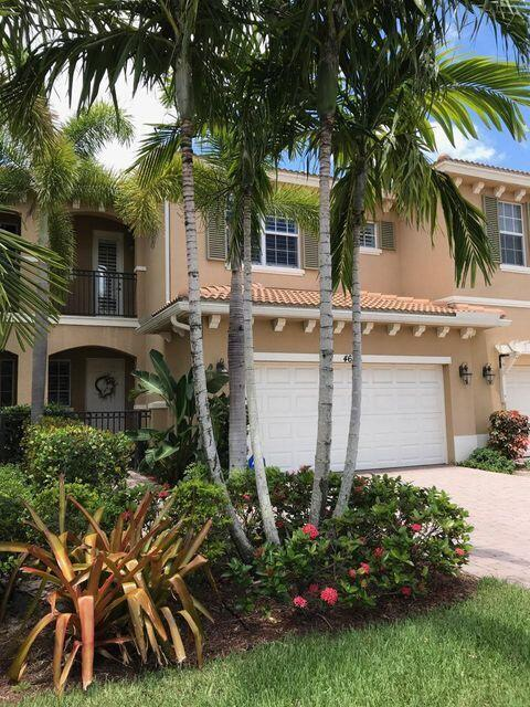 Beautifully decorated townhome in a gated community in Palm Beach Gardens.Fenced yard and Lake view.  Lots of amenities and close to many restaurants, I95, and the turnpike.   great schools.