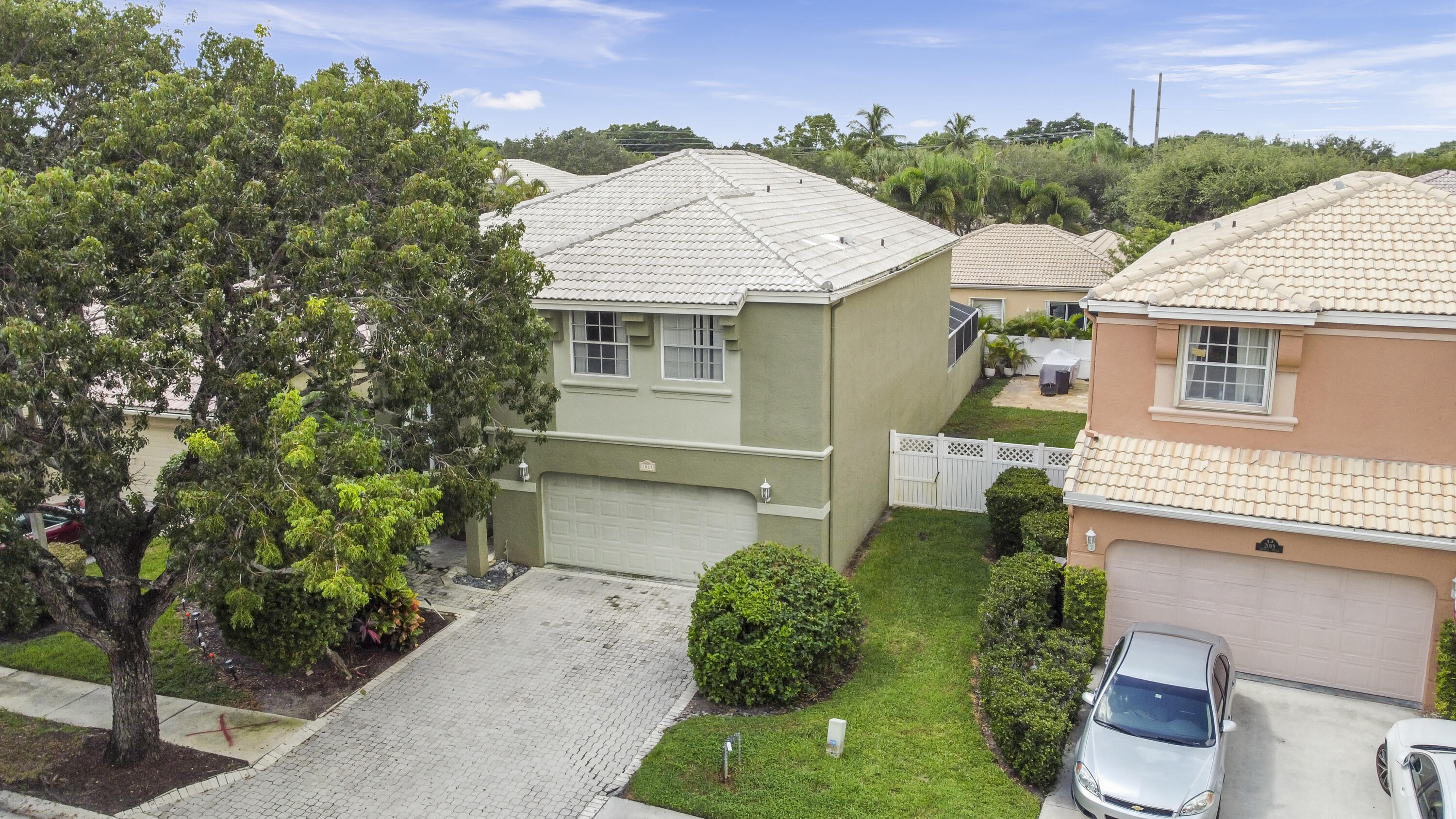 Two story, single family home in the desirable Classics at Bear Lakes. Centrally located to 95, the outlet mall and minutes from Downtown WPB. This 4 bedroom home has a screened in patio with a beautiful pool, huge master bedroom, den/office area downstairs, no carpet & great floor plan. AC was installed in 2017 along with a new water heater & pool pump. The dishwasher was installed in 2018. Basic landscaping is included with the HOA along with great amenities in the community!
