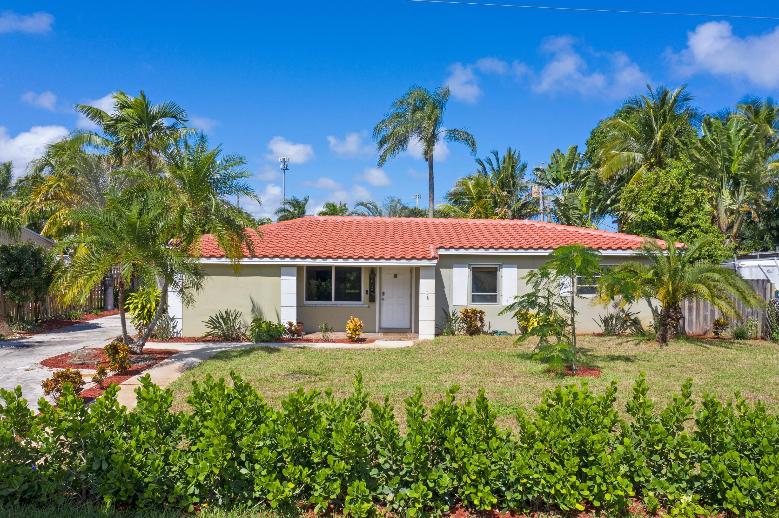 Fabulous opportunity to own in this highly sought after EAST DELRAY neighborhood, minutes from the beach and famed Atlantic Avenue. Make this charming four bedroom, 2 bath ranch style home your own or create a perfect investment opportunity. Graced with a sprawling open floor plan that features a formal living room, dining room, family room and eat-in kitchen with granite countertops and stainless steel appliances. Enjoy effortless indoor/outdoor entertaining in the spacious family room with stone fireplace that opens onto the 320 sq foot screened in covered patio. Highlighted features include a NEW ROOF, installed in December 2020, new A/C, and newly installed partial impact glass. Air conditioned shed/storage room can be easily converted into a studio or used for additional storage.