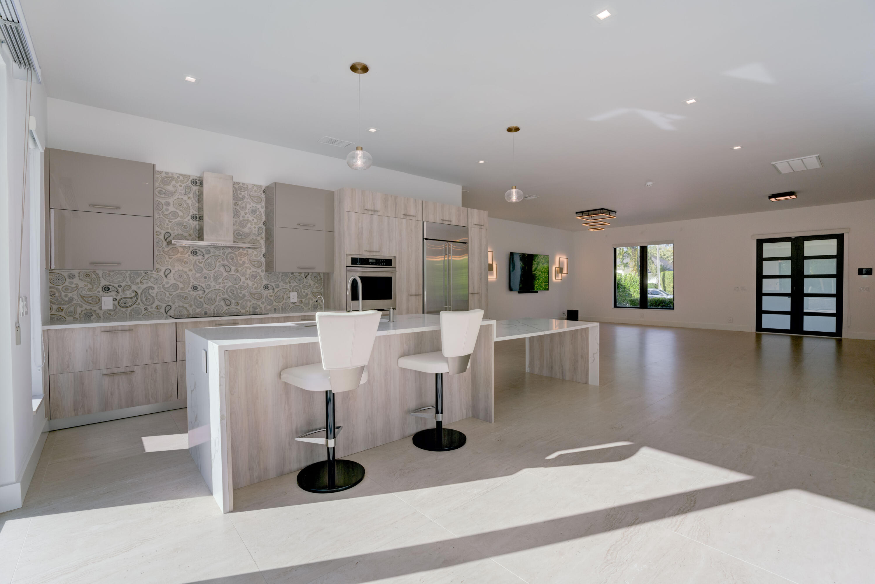 Rare Modern home available for lease annual unfurnished. Completely gutted and redesigned into a Modern and spacious 4 bedroom. 10-12 Ft. Ceilings throughout Monogram kitchen appliances oversized Calcatta Gold Quartz kitchen island. 3 spa like full bathrooms with rain head showers. All impact windows and sliding doors. LED lighting integrated with smart home technology and HD camera security system. Extended driveway to accommodate multiple vehicles. Grade A+ Jupiter Schools. Best location close to Alton, PGA and Jupiter restaurants and shopping. Within walking/biking distance to Juno Beach. 50 Ft heated lap pool with modern waterfall and sun shelf. Lawn and Pool Care included in the rent.