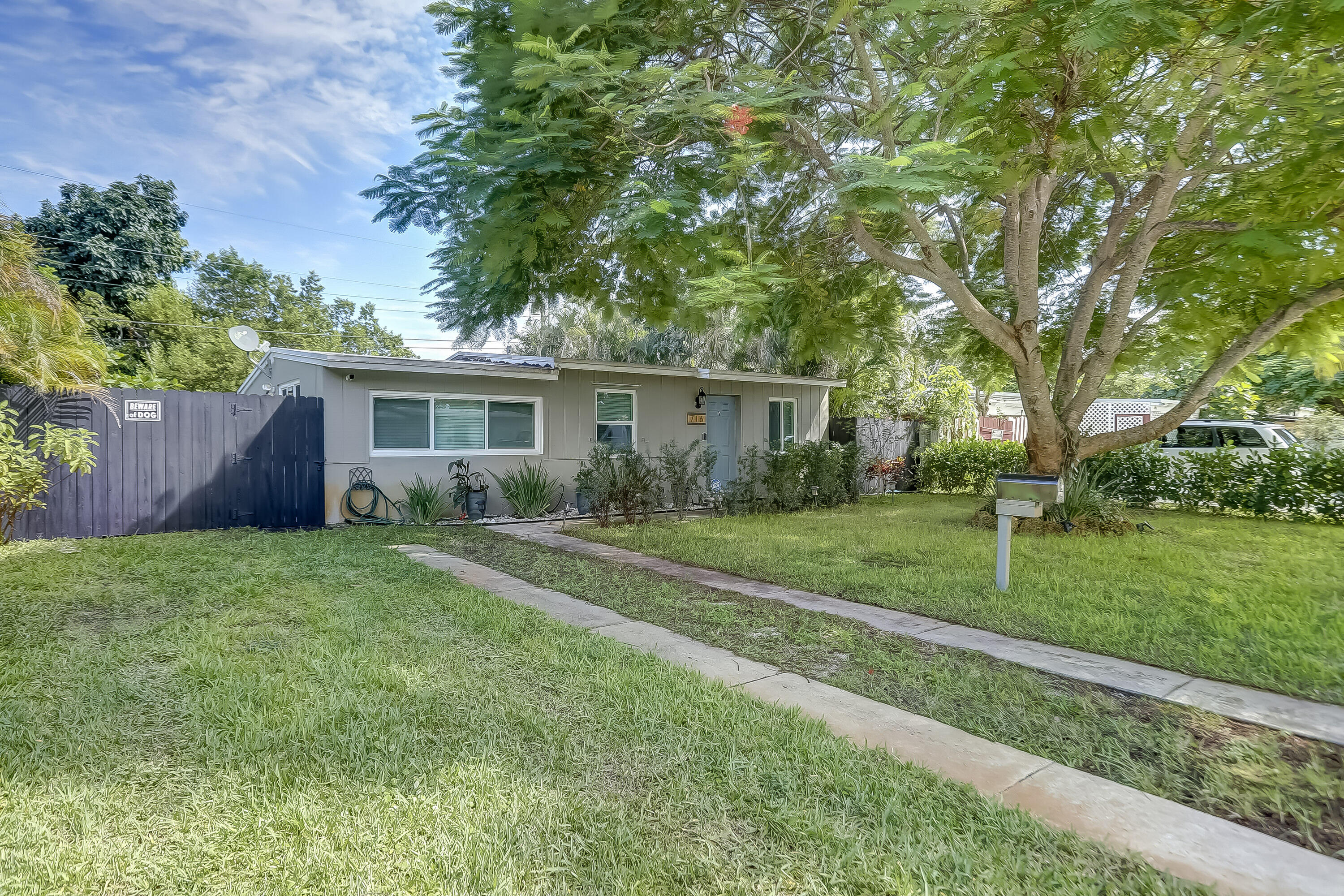 THIS is your new home! Remodeled, updated and ready for you! NO HOA! Dive in to the pool and enjoy the lush and serene backyard! **Showings start @ Open House - 10/24/21 from 11am-2:30pm ** Once inside you'll be greeted with tile flooring throughout, Hurricane/Impact Windows and Doors and a new AC system! Live less than 3 miles from the beach! The roof is less than 10 years old!