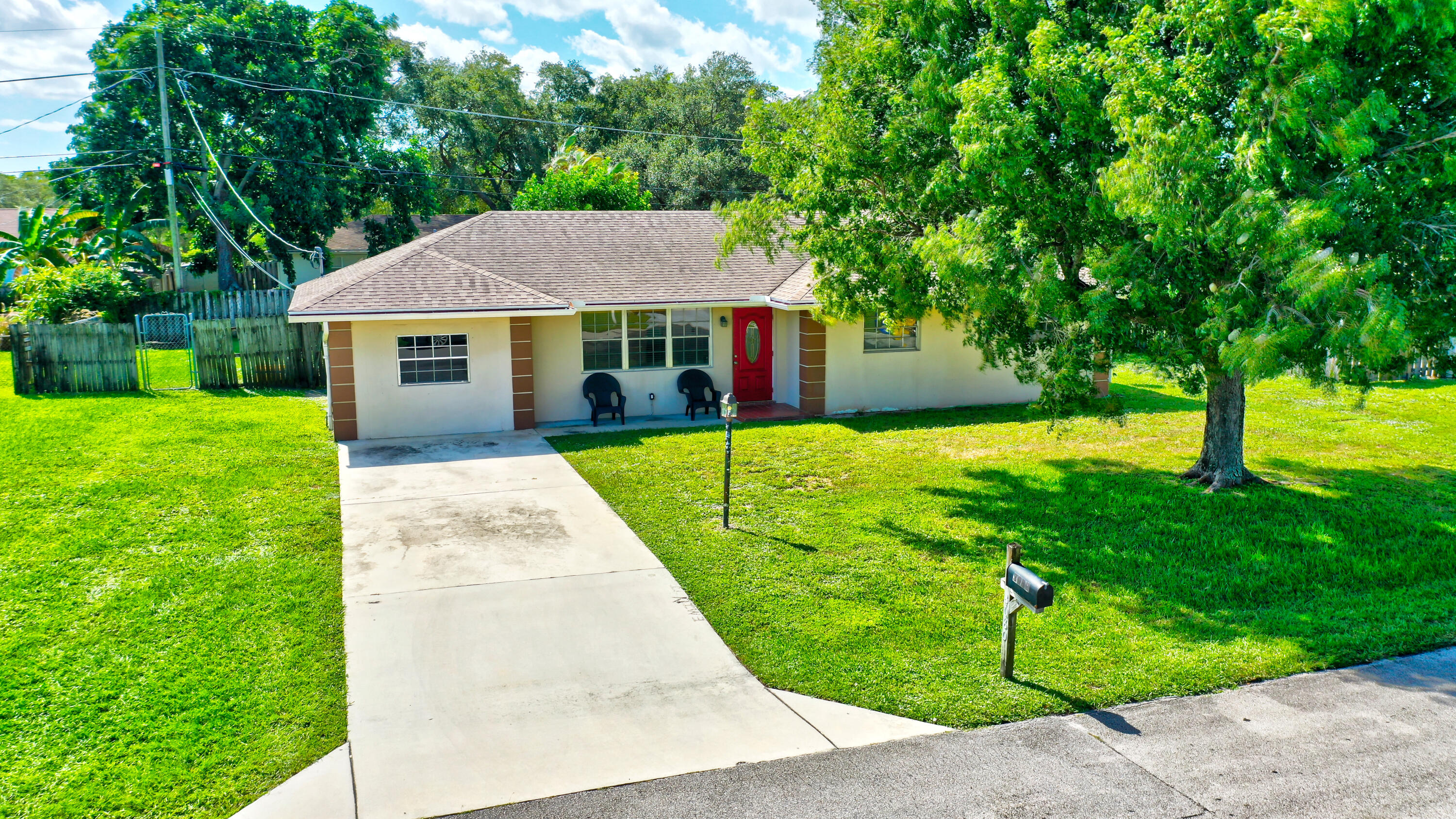 **No Showings Until Open House Sat 10/23 12-3pm & Sun 10/24 1-4pm** All offers due by Mon 10/25 at 5pm** Charming 4 Bed / 2 Bath home in the desirable Unincorporated Lake Worth. Perfectly priced, This home packs lots of wonderful features with great upgrade potential. Features such as a Large Kitchen, Solid wood Cabinets, Granite counters, Tile floors, Fully remodeled master bath, Converted Garage into 4th bedroom, large family room, spacious living room, Formal Dining, carpeted bedrooms & so much more.The large fenced back yard is perfect for entertaining. Equipped with a large spacious screened in lanai, plenty of room for a pool, additional parking for a boat, plenty of pay room for family & pets.Quiet neighborhood with no HOA, conveniently located in the center of it all. Just minutes to Highways, beaches, gyms, schools, shopping, restaurants, golf, dog park, bike trails, John Prince Park, and lots of entertainment. This home will go quickly! Make this your home today!!