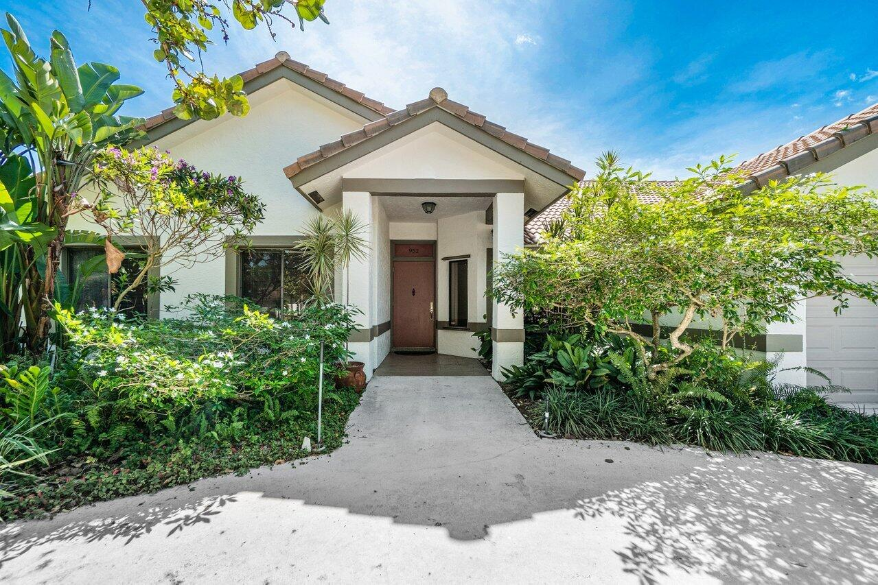 Remarkable East Boca home on oversize lot .35 acres  - over 2700 sq. ft. - open floor plan - new master bath 2021 - new 2020 main A/C - energy saving photo-voltaic system tied into the grid and solar HWH save money/benefit environment. Vaulted ceilings in main living area and primary bedroom. Bedroom #5/bath #3 have separate entrance - perfect for extended family, art/yoga/exercise studio or excellent work-from-home or homeschool space.  Home has been well cared for 20+ years by current owners. Pool resurfaced and new tile 2021.  Beautiful backyard garden - peaceful and serene! Main electrical panel upgraded 2015 and household surge protector added. Hurricane panels for all glass openings - front door, garage front and side doors impact resistant. Addison Mizner/Boca Middle/Boca High. See Hot water heater 80 gallons - heated by solar panel Roof 2001 - see additional info below Photo Voltaic system 2006 - first system in S Florida tied to grid. 2600 Watt system with supplies approx. 20% of annual energy needed in the home. Has generated 50,000 KW hours to date. Kitchen floors and counters redone 2009 Main electrical panel replaced/rewired/upgraded 2015 Household surge protector 2015 Roof solar Hot Water panel Garbage disposal 2015 Garage door Hurricane Impact Resistant 2016 Dishwasher - Bosch 2019 Pool pump 2019 Main A/C 2020 - 5 ton, 16 SEER Rheem split system with UV disinfectant system Garage side door Hurricane Impact Resistant 2021 Pool resurfaced and tiles replaced 2021 Master bathroom completely renovated 2021 House exterior repainted 2021  Roof replacement in 2001 - Caldwell Roofing - the following additional reinforcement was done per owner: - gables all reinforced with cross ties for hurricane wind conditions to resist leaning out/in (assorted 2x4,6 and 1x2,4 elements as needed) - The two large Gables (west and east) secured to wall concrete tie beams below with structural steel 90 degree angle plates every ~ 3ft using tapcons , and lag screws into the Gabl