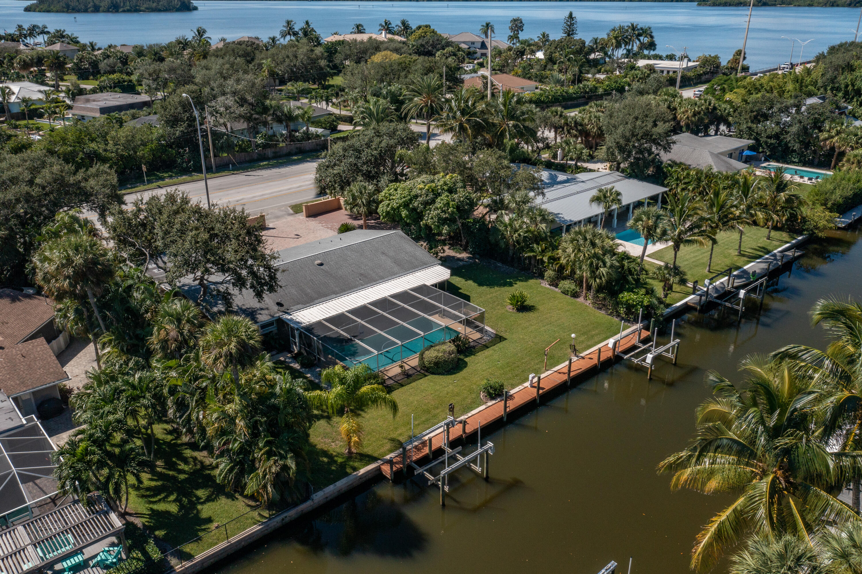 Deep water, canalfront home on Vero's Barrier Island with direct Intracoastal access. 4BR/3BA, CBS home. Large, screened pool, private dock with 2 lifts (updated 2020) and partially reroofed in 2015.