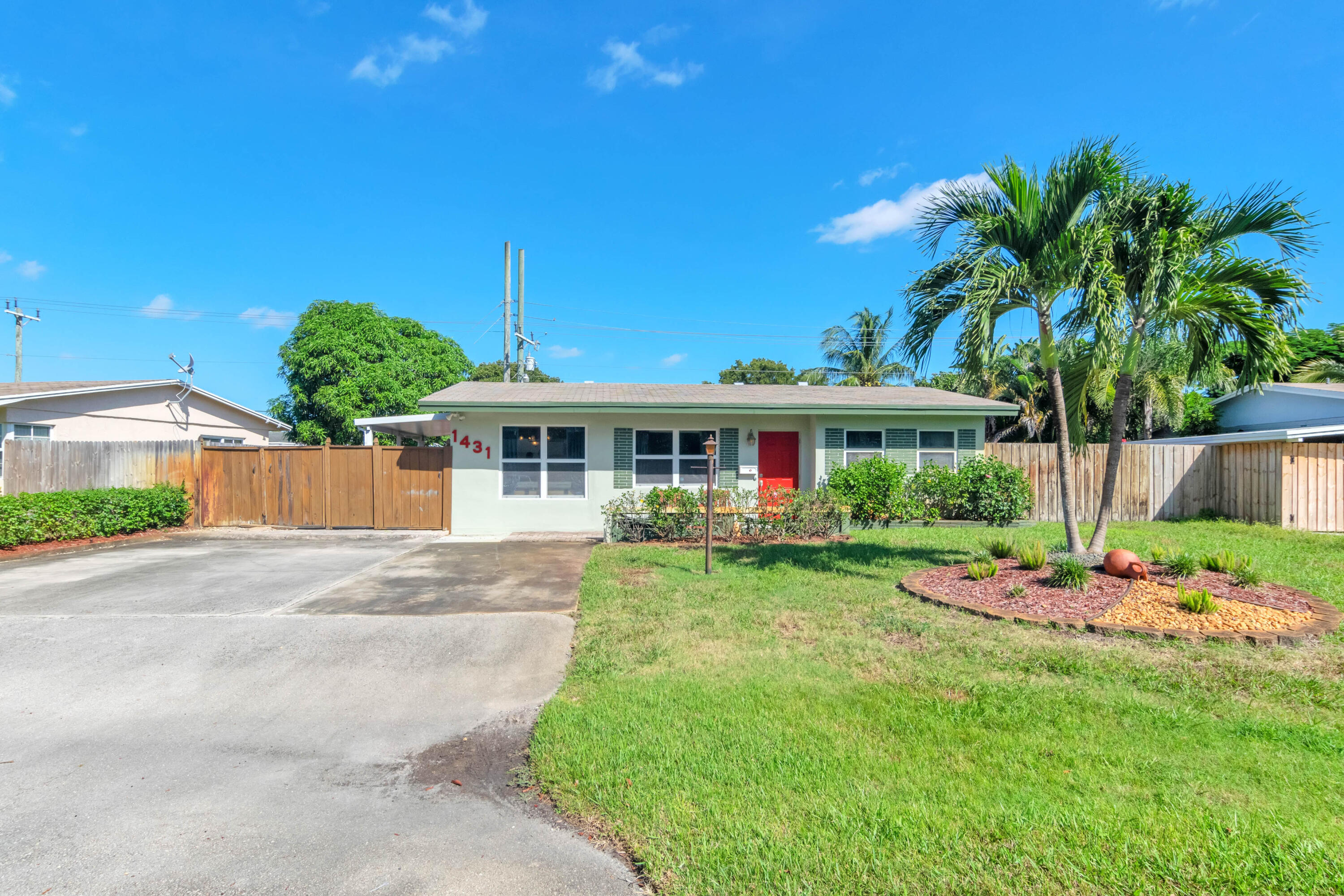 Come see this Beautiful 2/2 in East Pompano Beach. Home features impact windows, Brand new A/C, Custom designer kitchen, updated floors throughout, triple driveway, amazing backyard for entertaining, and many more features. Very easily made into 3 bedroom home with minimal work.  This home is located just off Federal highway close to shopping, beach, great parks, and amazing restaurants. There is no HOA so bring your boats and toys. 5 minute ride to boat ramp. Call today for your private showings.